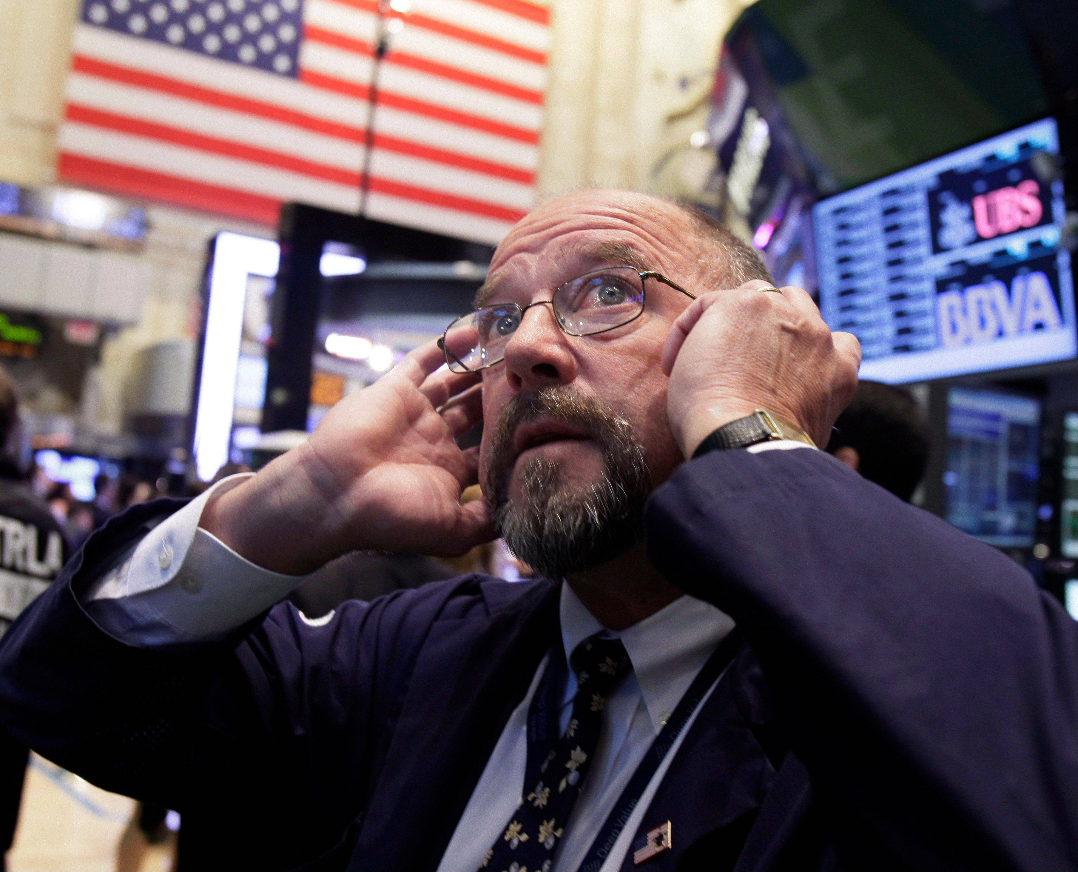 U.S. stocks declined, erasing earlier gains after benchmark indexes approached five-year highs, amid concern that global stimulus measures won't be enough to boost growth at the world's largest economy.