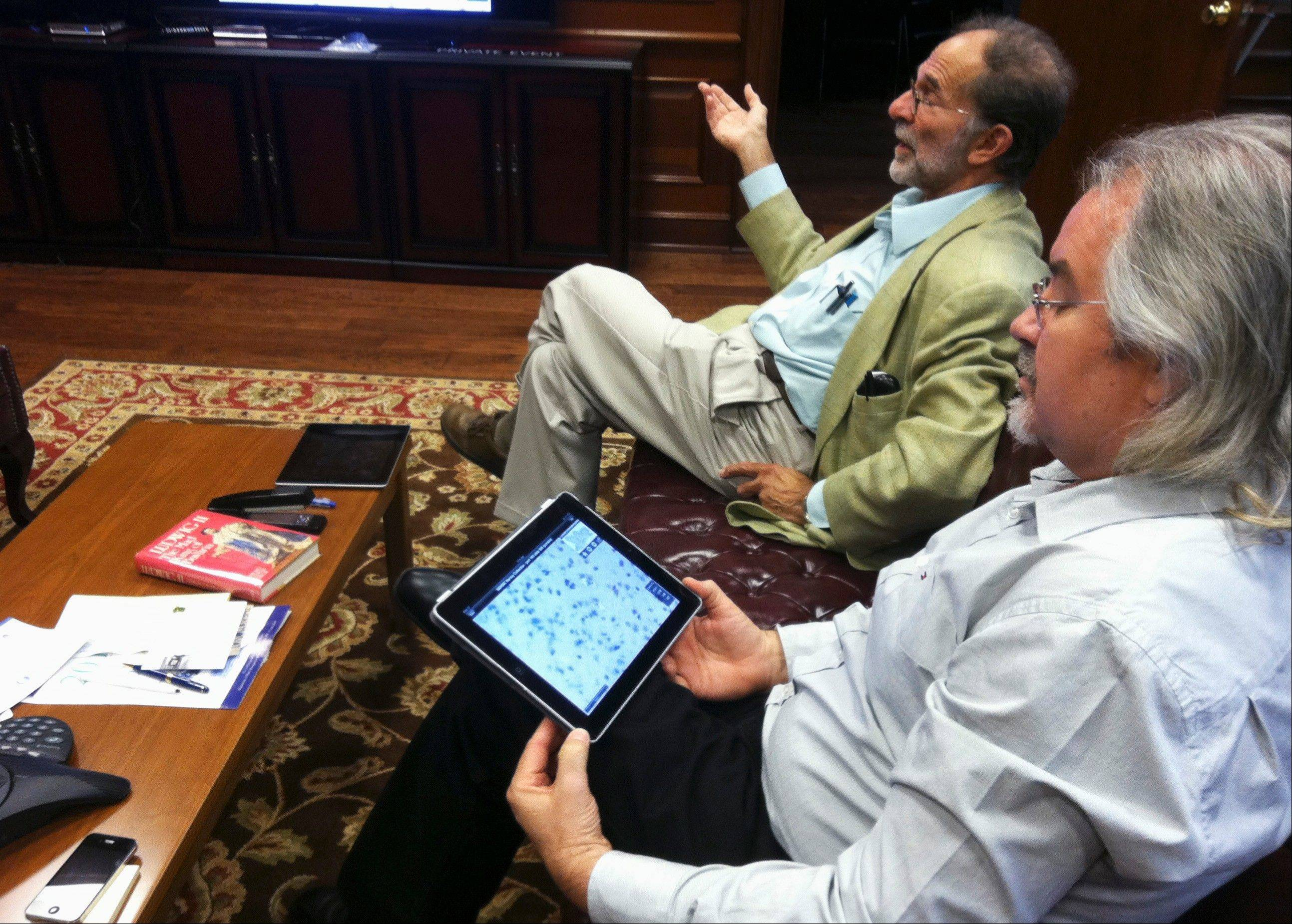 Dr. Phillip Epstein, left, and Steve Landers of the National Museum of Health and Medicine Chicago talk about the new iPad app being released Tuesday