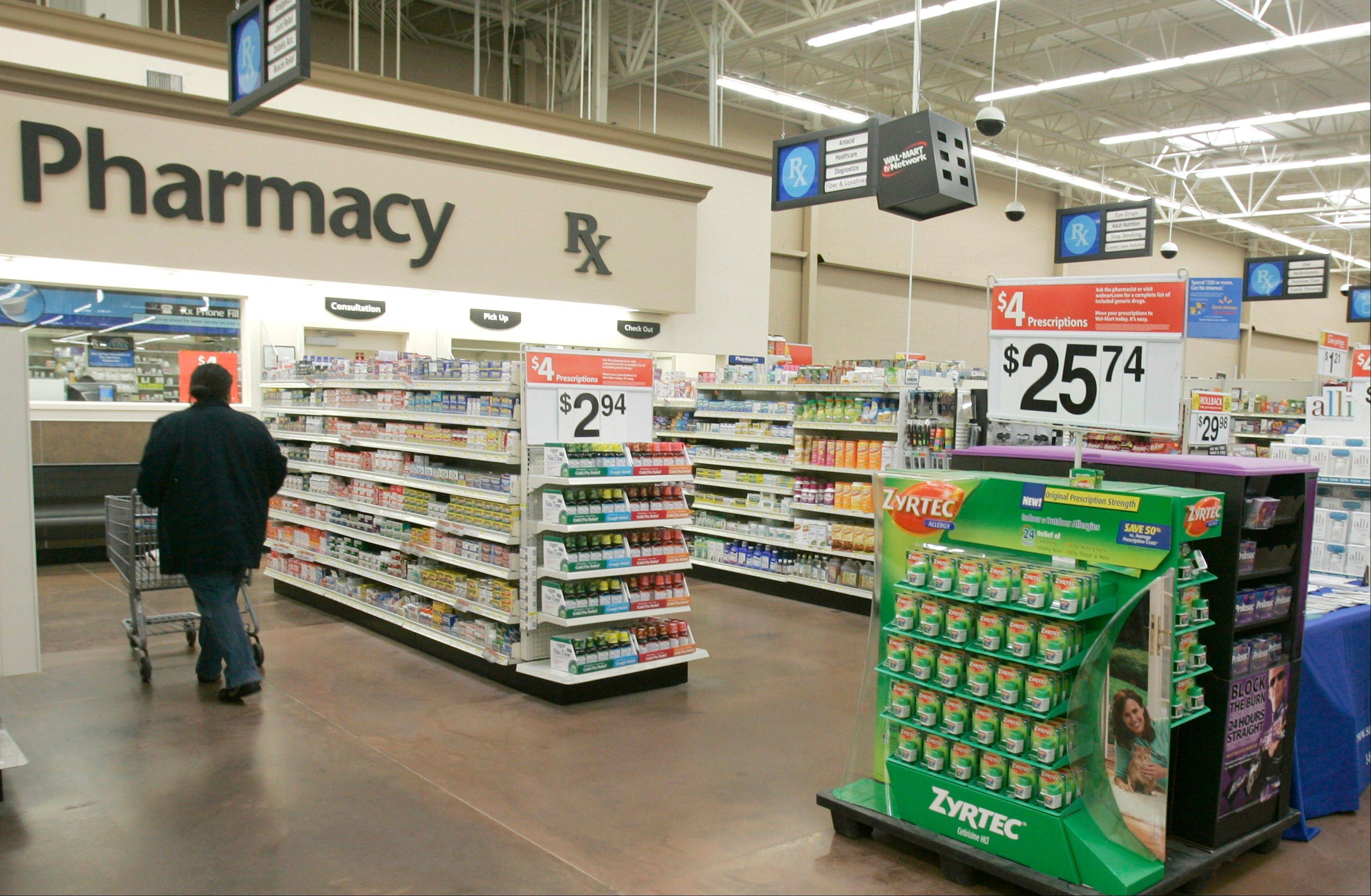 A shopper walks toward the pharmacy at a Little Rock, Ark., Wal-Mart store. A study says seniors in seven of the 10 most popular Medicare prescription drug plans will be hit with double-digit premium hikes next year if they don�t shop for a better deal.