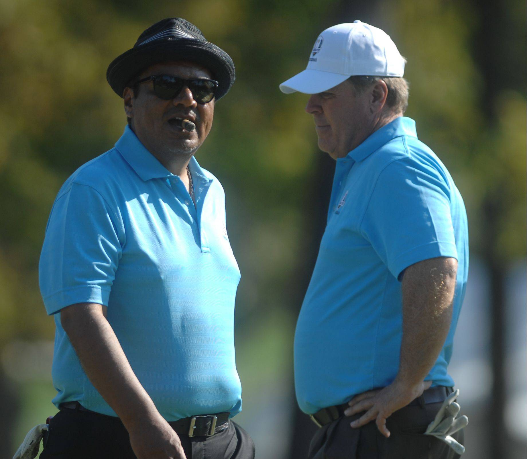 Actor George Lopez, left, and PGA golfer Hal Sutton at the 4th hole of the celebrity scramble Tuesday at Medinah Country Club.