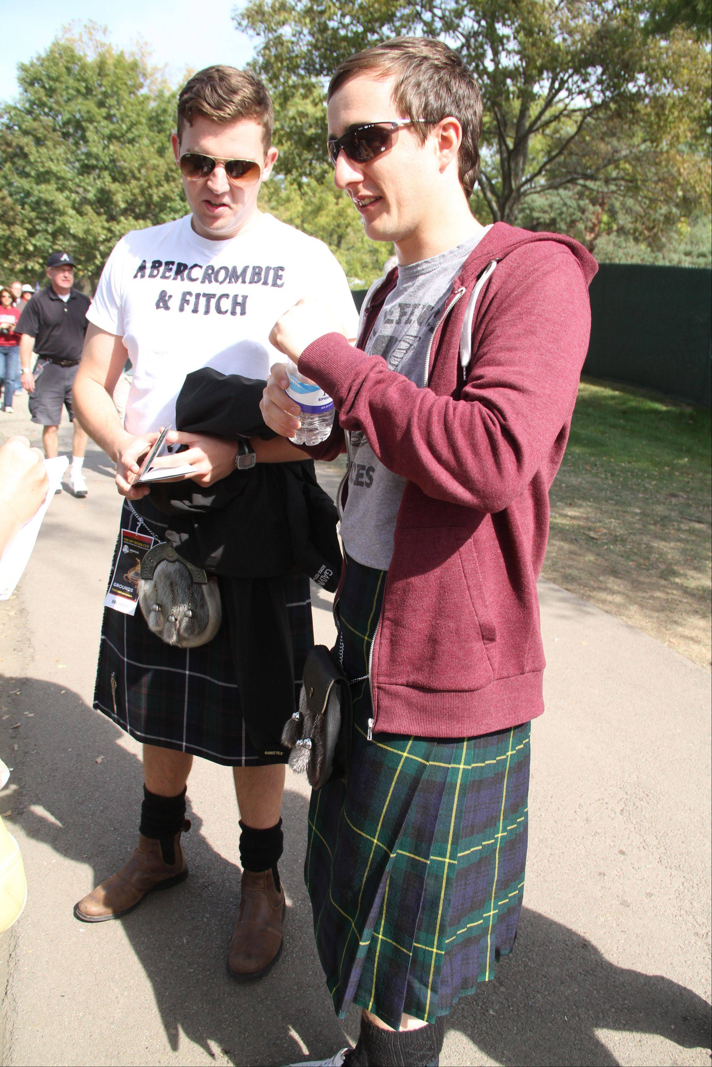 "Scott McCreadie, left, and Mike Brown, of Carnoustie, Scotland, wore a dressed down version of the traditional Scottish outfit, pairing their kilts, wool socks and sporran (a type of kilt purse) with T-shirts. They wore kilts to show support for Team Europe's Scottish golfer Paul Lawrie. ""The idea is to look European straight off,"" Brown said. ""There's no question who we're routing for."""