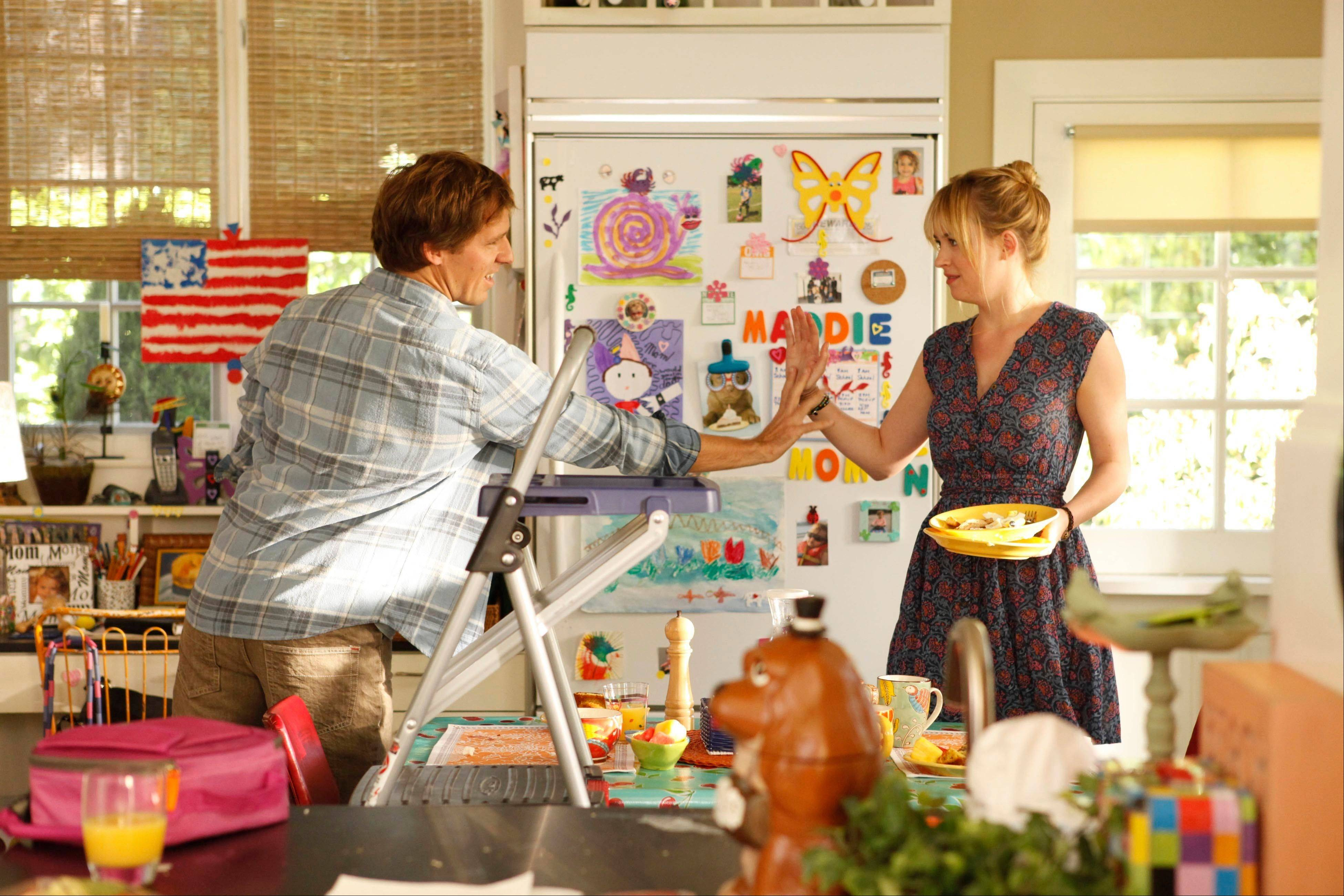 "A free-spirited brother (Nat Faxon), left, drops in on his more uptight and responsible sister (Dakota Johnson), a single mother, in the new Fox sitcom ""Ben and Kate."""