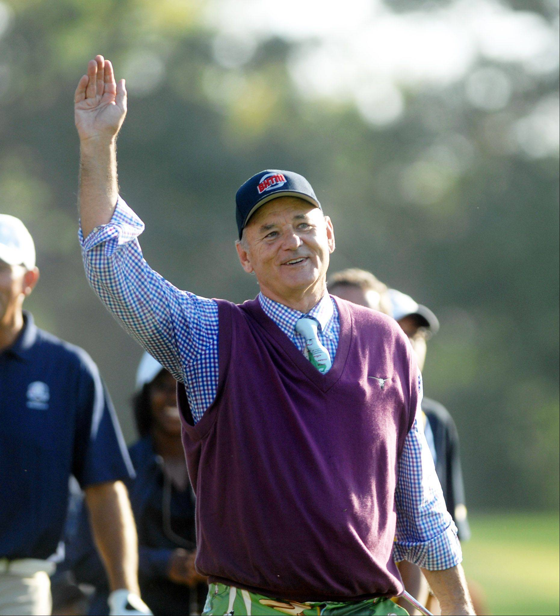 Movie Star Bill Murray waves goodbye to his fans as he leaves the 7th hole. This took place during the Celebrity Scramble Exhibition Tuesday at the 39th Ryder Cup in Medinah.