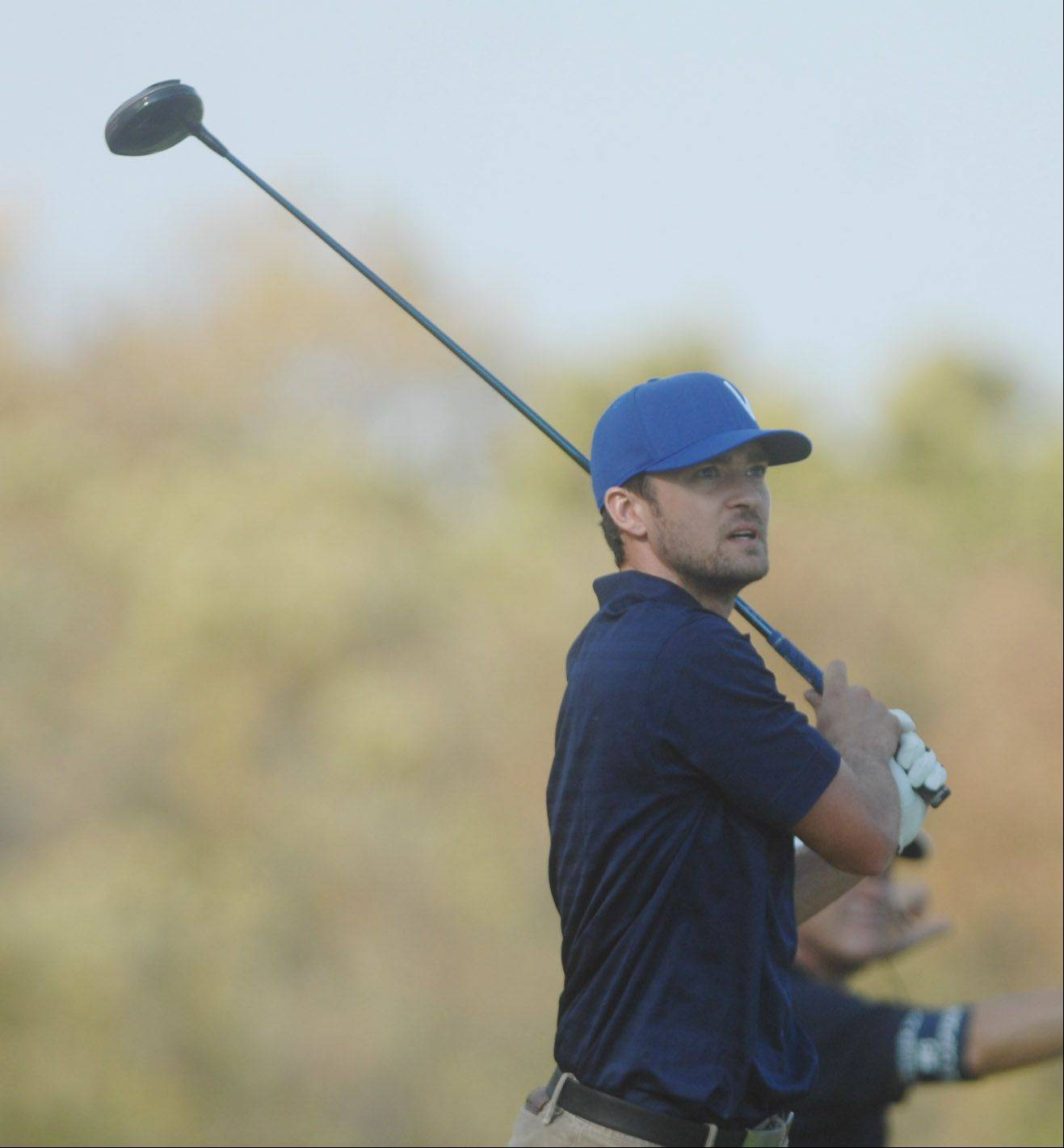 Movie star Justin Timberlake follows through on his swing on the 6th hole during the Celebrity Scramble Exhibition Tuesday at the 39th Ryder Cup in Medinah.
