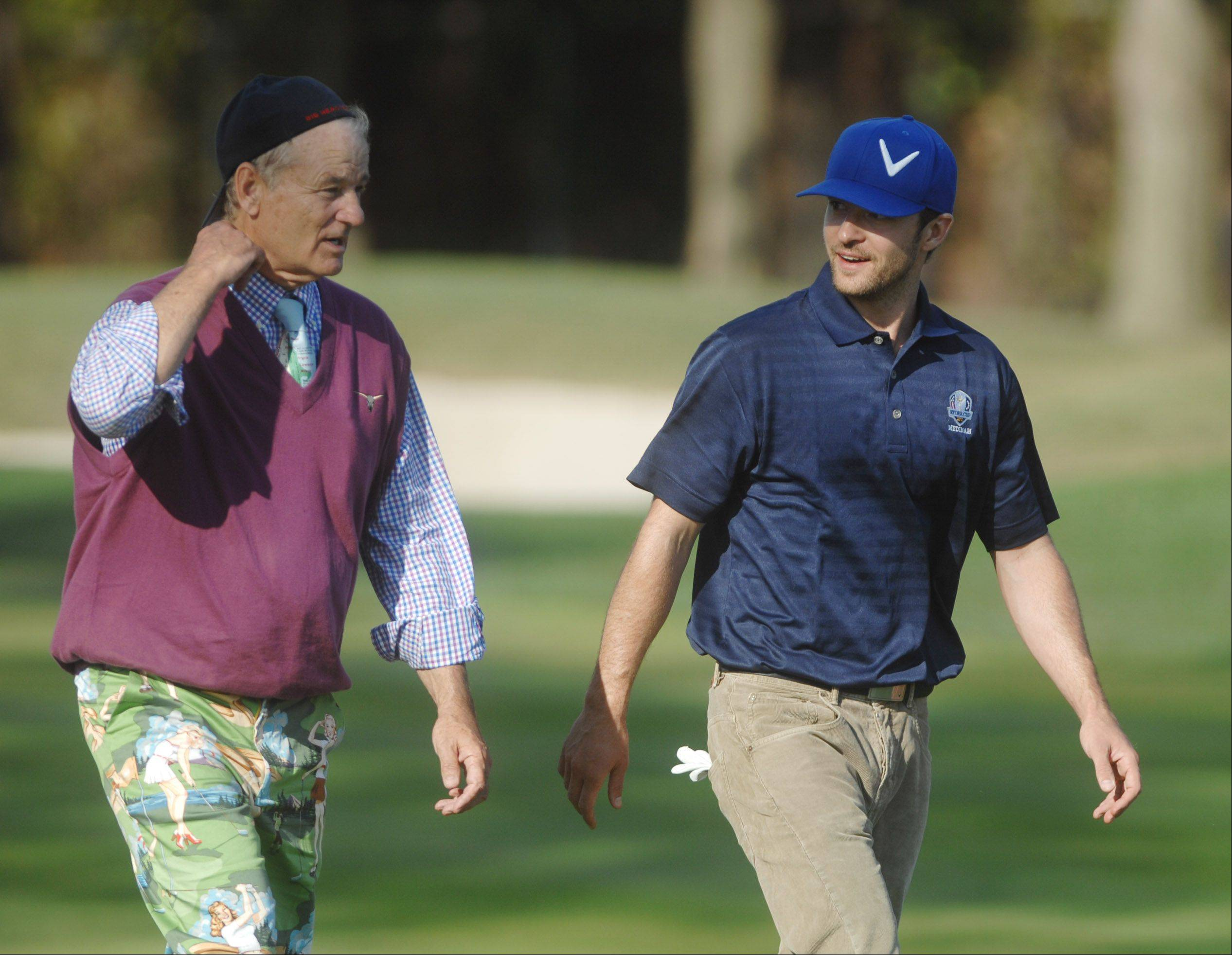 Bill Murray and Justin Timberlake chat it up between holes at the Celebrity Scramble Exhibition Tuesday at the 39th Ryder Cup in Medinah.