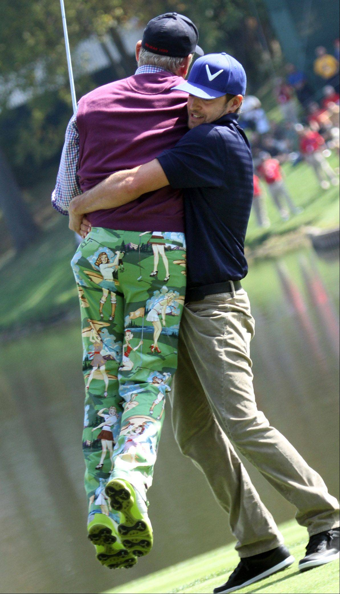 Justin Timberlake lifts up Bill Murray on the second hole.