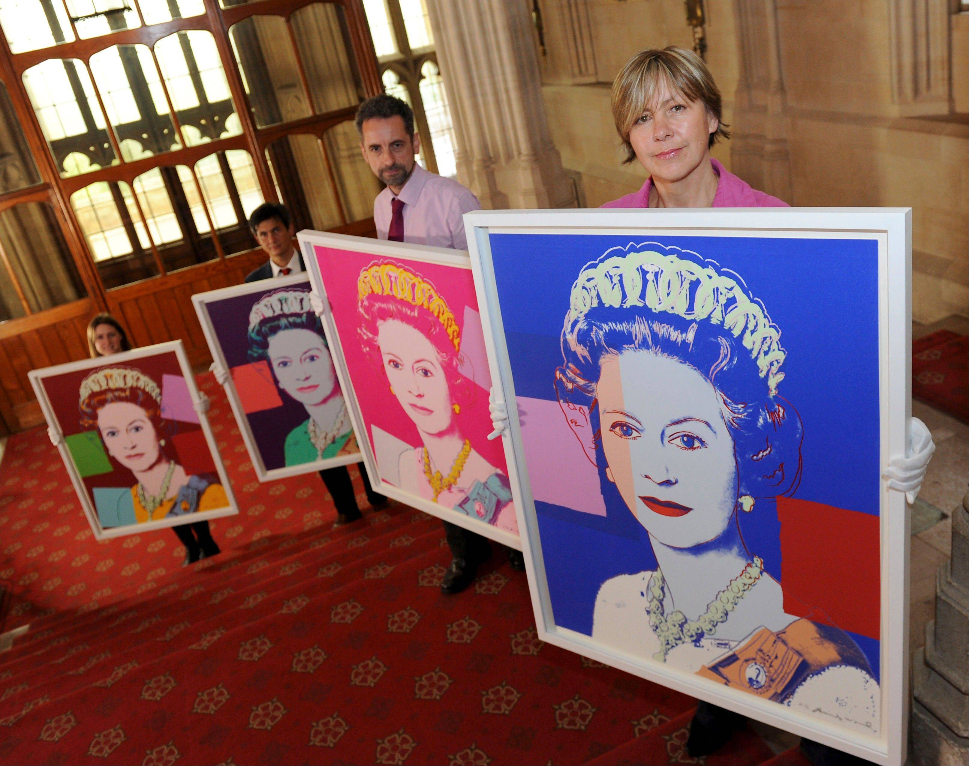 "Andy Warhol portraits of Queen Elizabeth II are displayed in Windsor Castle, Windsor, England, Monday. They will form part of the ""Portraits of a Monarch"" exhibit starting in November at the castle until June 2013. The screenprints are based on a formal photograph of the queen wearing a tiara and necklace that was used during her Silver Jubilee celebrations in 1977."