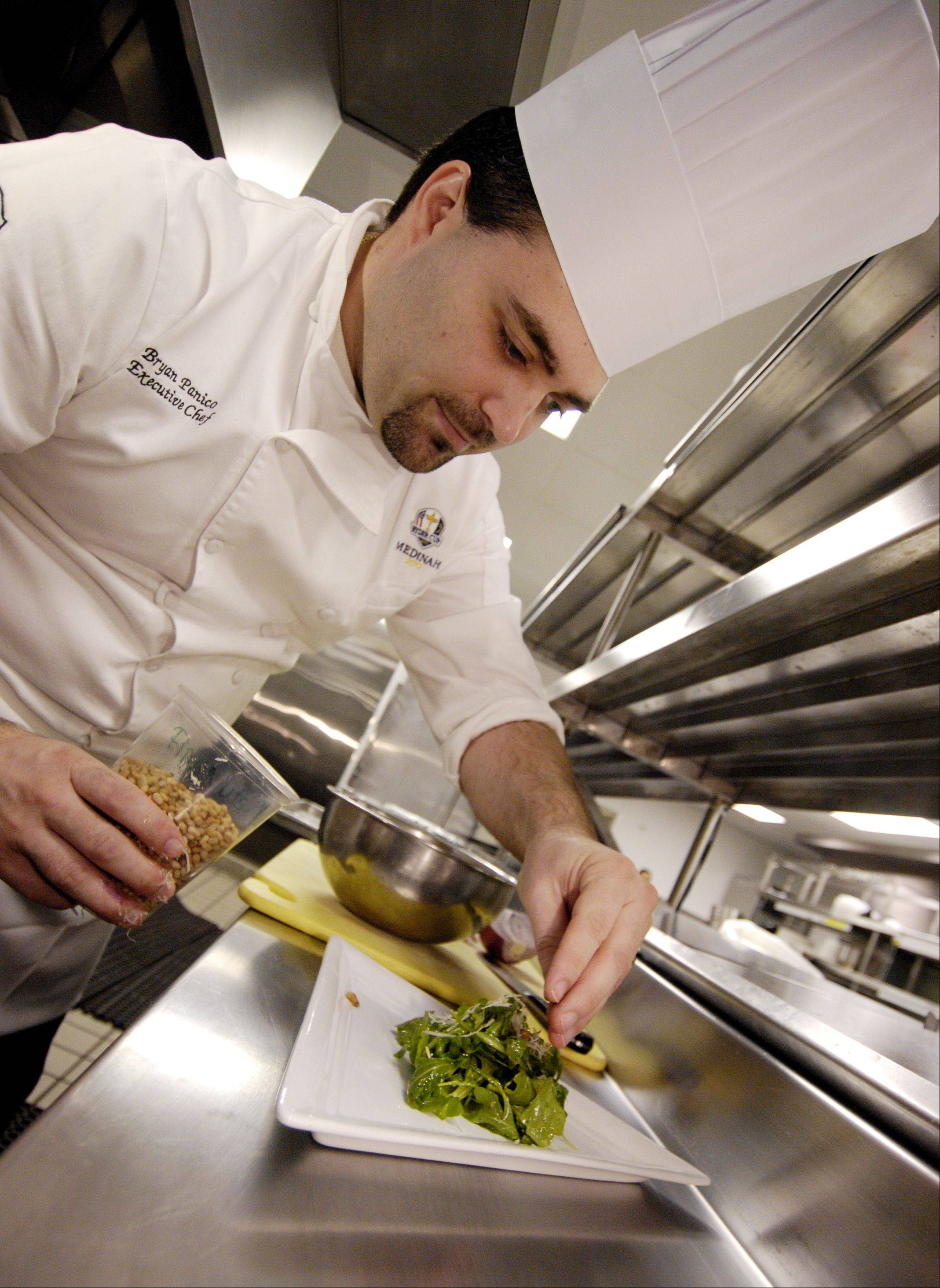 Medinah Country Club Executive Chef Bryan Panico prepares an arugula salad to serve alongside his pastry-wrapped pork and apple sausage.
