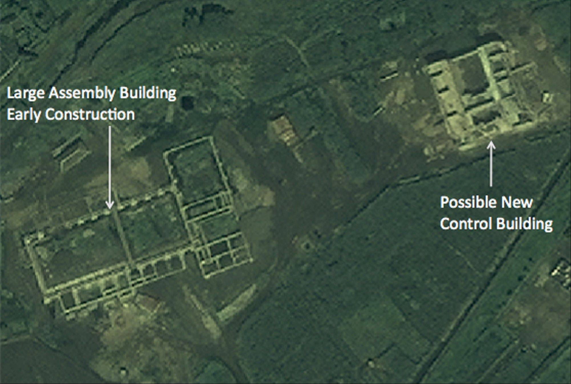 In this satellite image taken Aug. 29, 2012 by DigitalGlobe and provided Monday, Sept. 24, 2012 by 38 North, the website of the U.S.-Korea Institute at Johns Hopkins School of Advanced International Studies, structures which an analyst says a newly commenced construction site of what is probably a new rocket launch control center for the entire Tonghae launch complex and a large, still unfinished rocket assembly building are seen near the village of Musudan-ri on the northeast coast of North Korea.