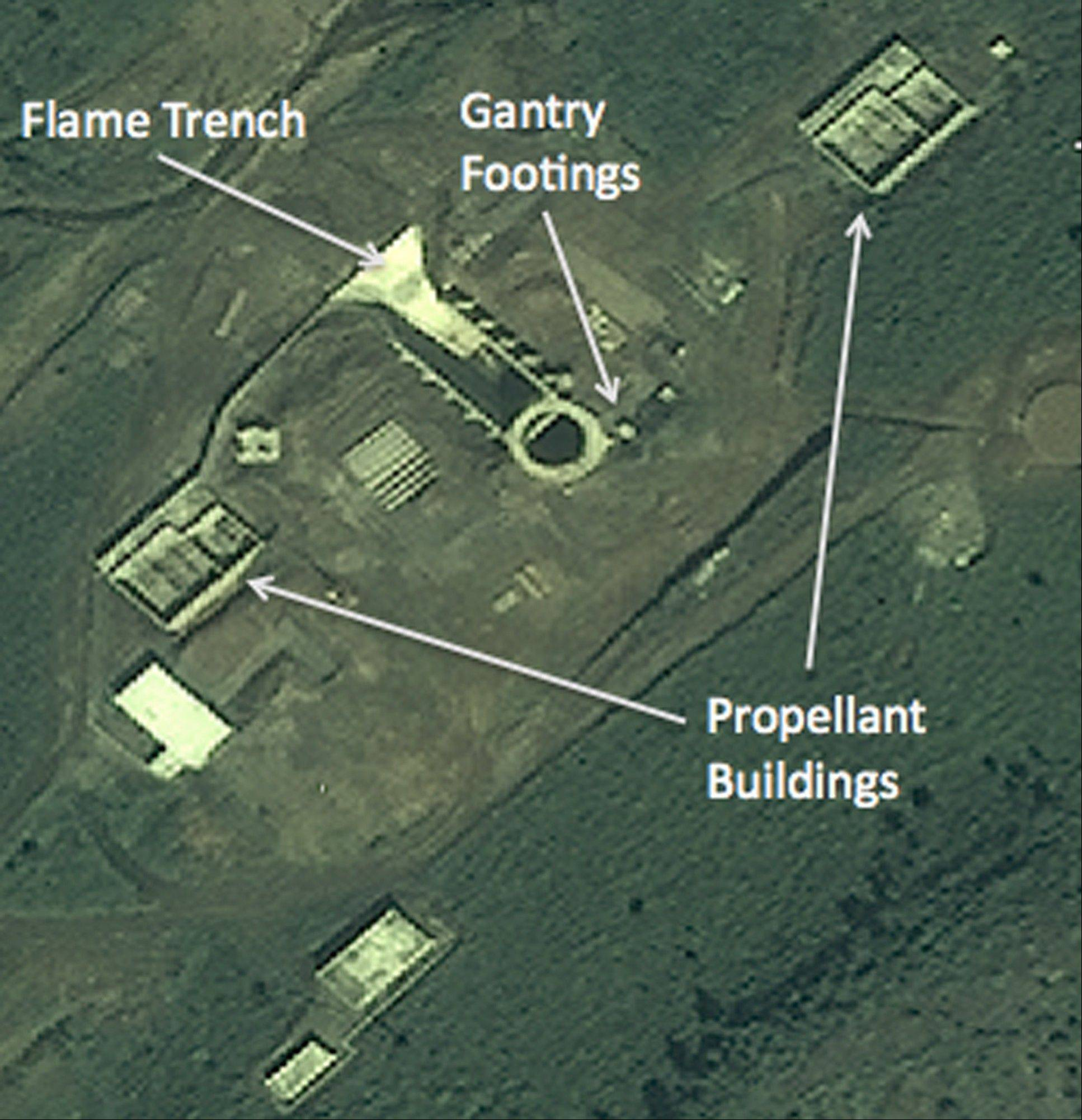 In this satellite image, structures which an analyst says are gantry footings, a flame trench and propellant buildings of a new launchpad are seen at the Tonghae launch complex near the village of Musudan-ri on the northeast coast of North Korea.