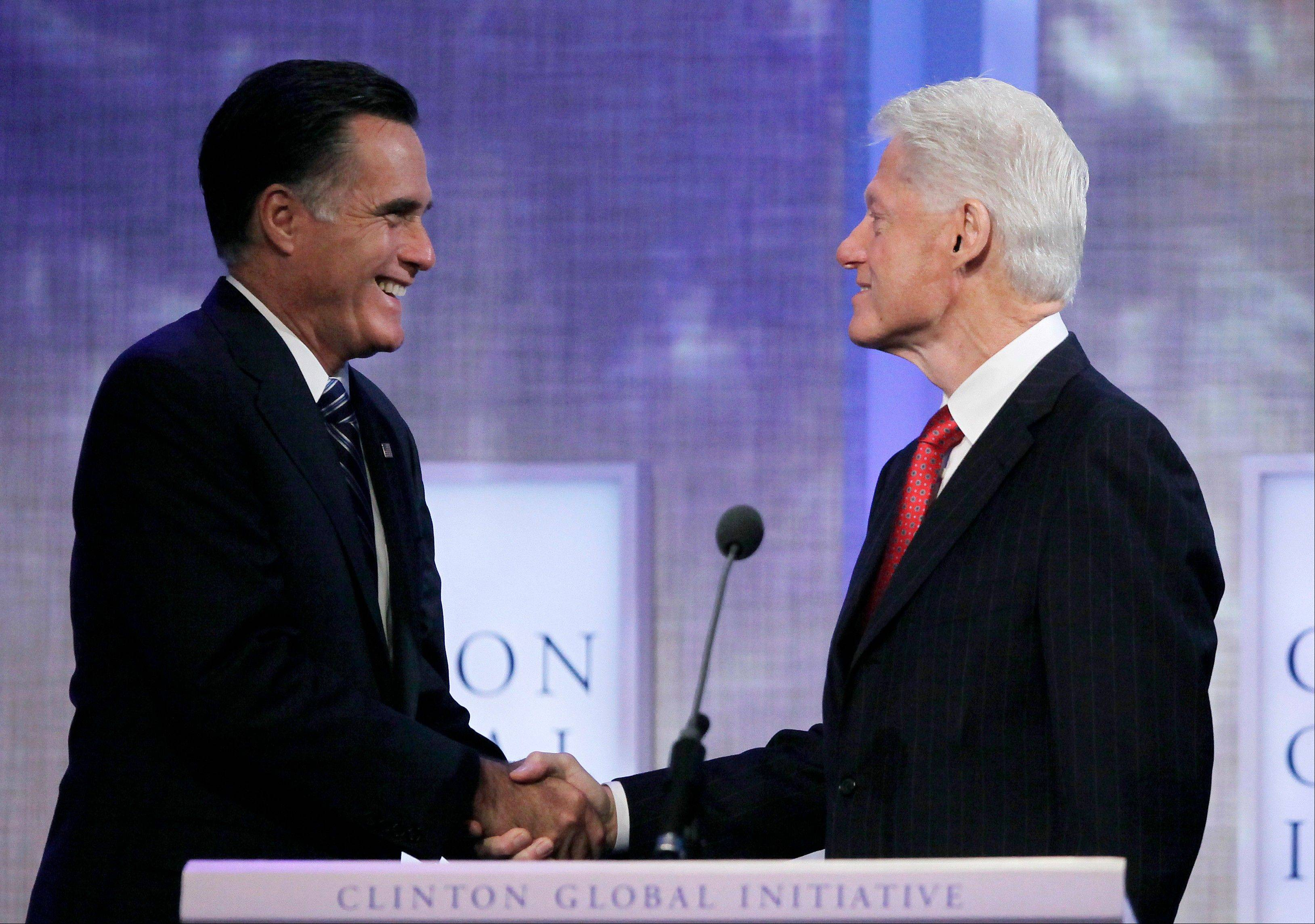Republican presidential candidate Mitt Romney shakes hands with former President Bill Clinton, Tuesday at the Clinton Global Initiative in New York.