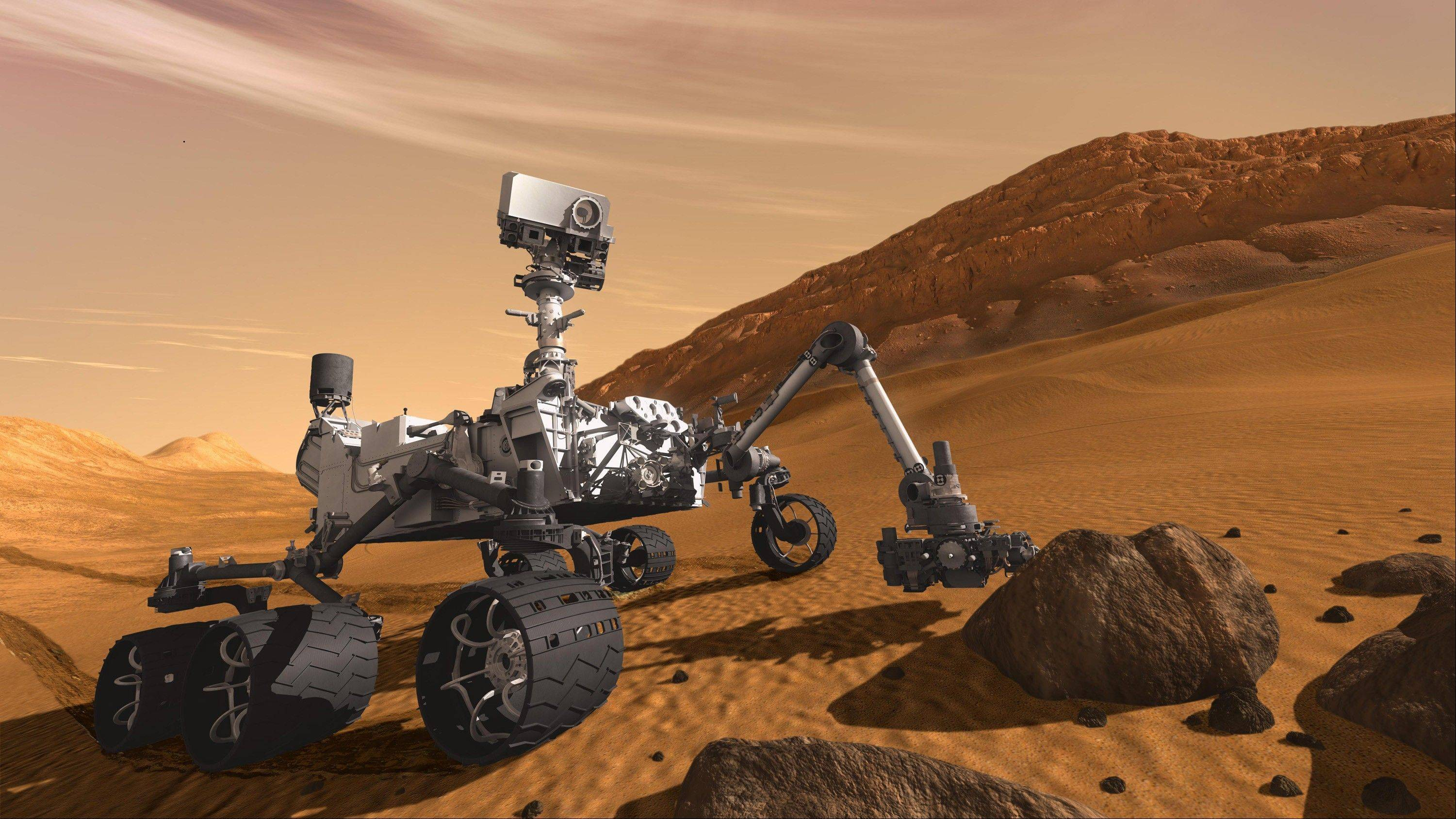 In this 2011 artist's rendering provided by NASA/JPL-Caltech, the Mars Science Laboratory Curiosity rover examines a rock on Mars.