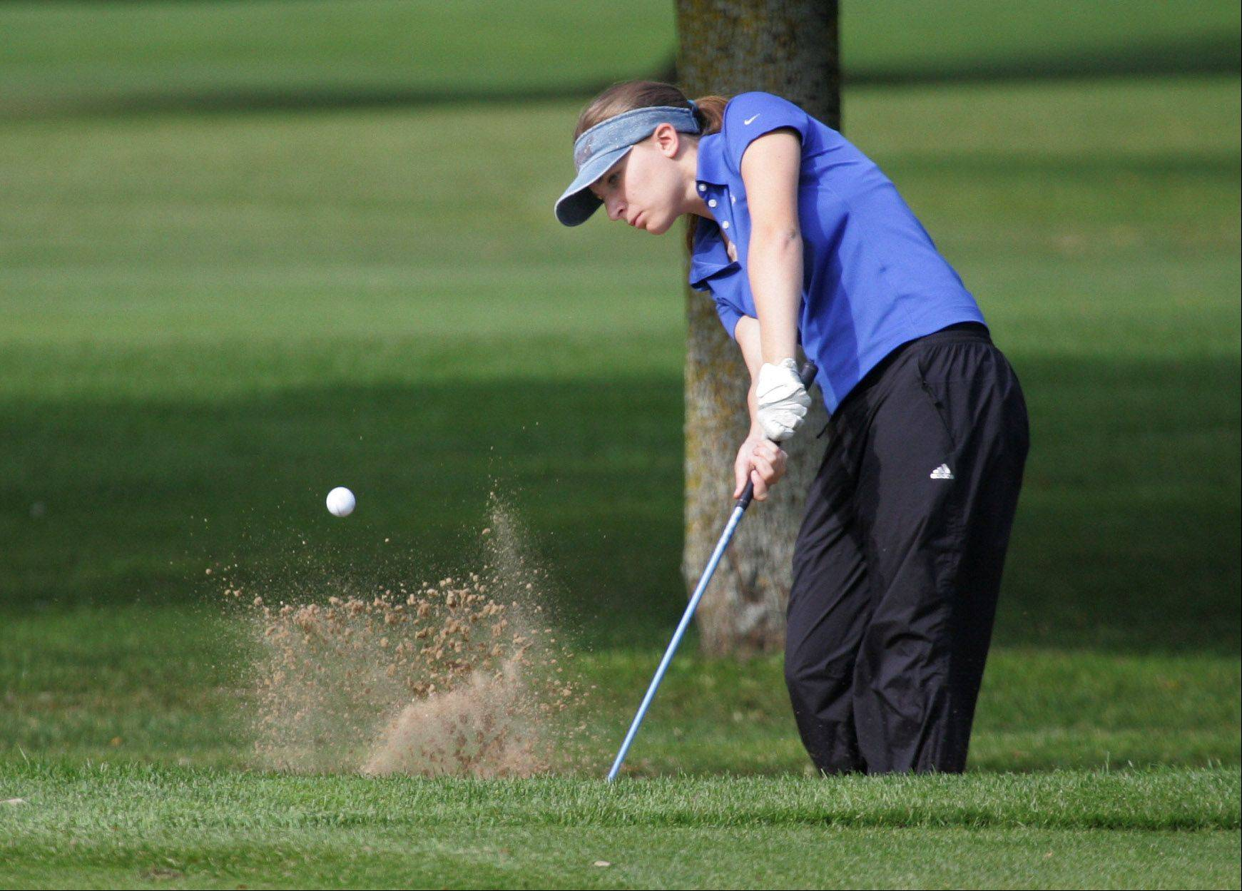 Lake Zurich golfer Melissa Uhl hits out of the sand on the 6th hole during the North Suburban Conference girls golf tournament Tuesday at Deerpath Golf Course in Lake Forest.
