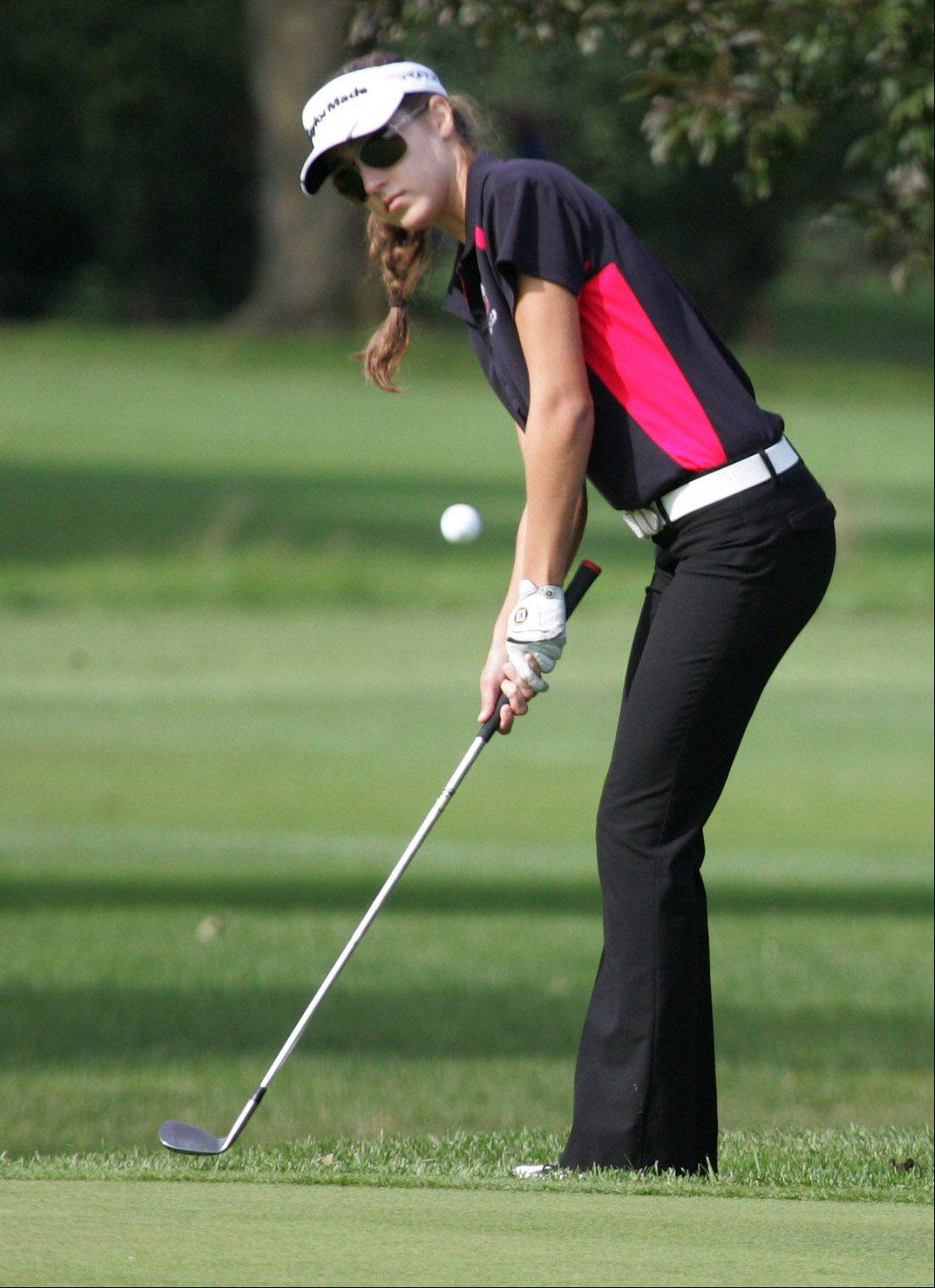 Mundelein golfer Courteney Fabbri piches her shot up onto the green on the sixth hole during the North Suburban Conference girls golf tournament Tuesday at Deerpath Golf Course in Lake Forest.