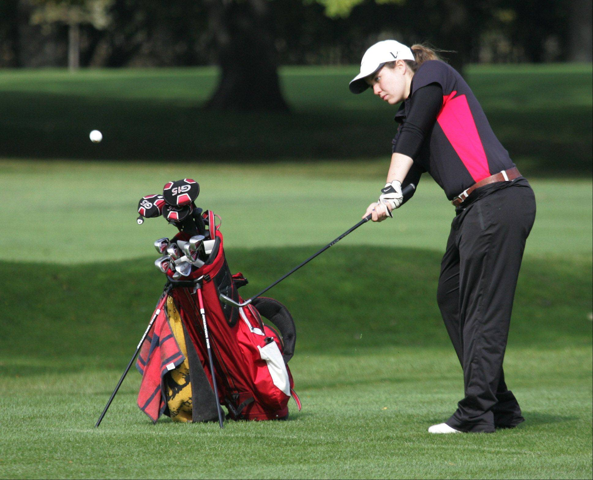 Mundelein golfer Holly Gutlund on the sixth hole during the North Suburban Conference girls golf tournament Tuesday at Deerpath Golf Course in Lake Forest.