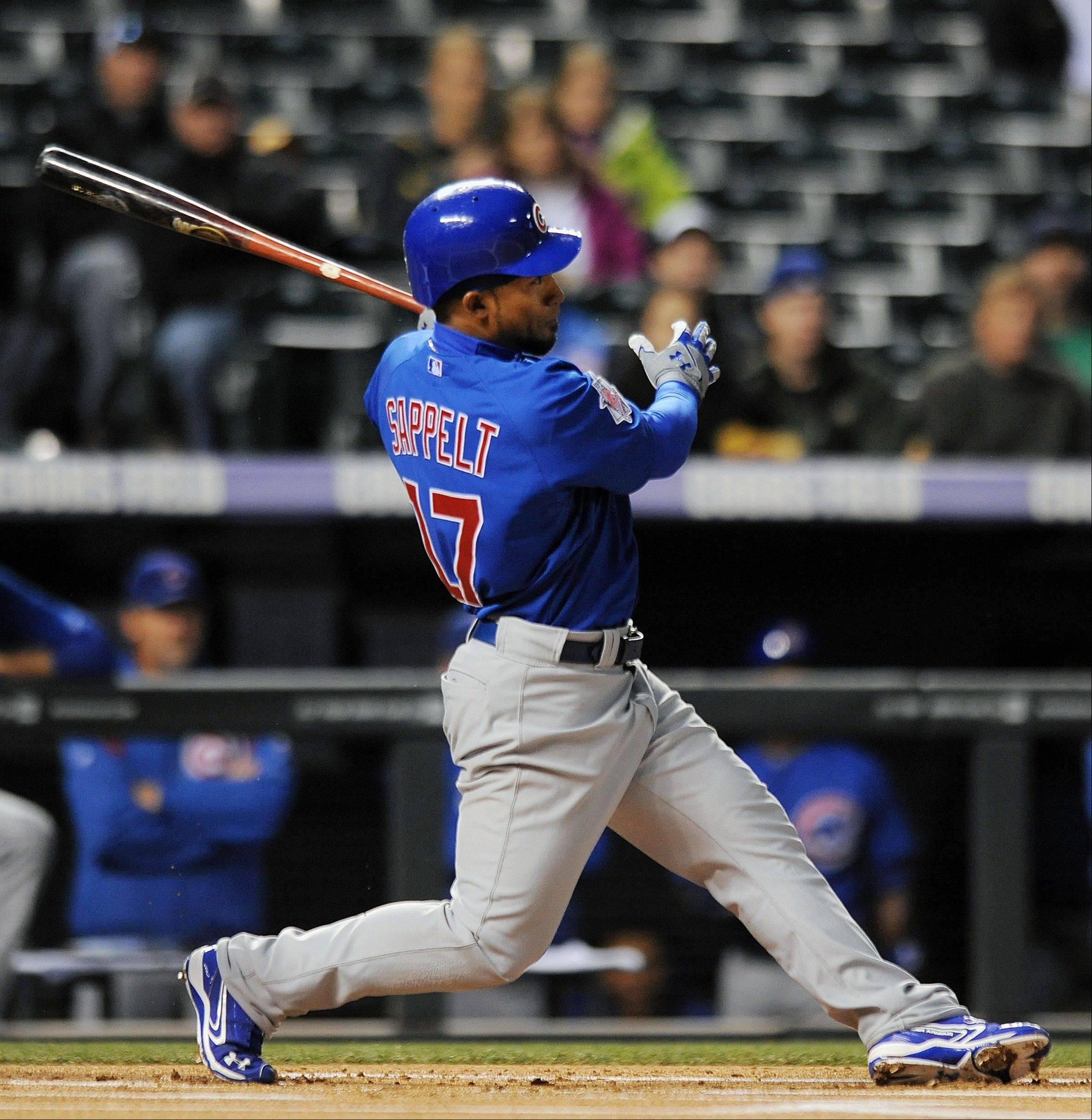 The Cubs' Dave Sappelt hits a home run Tuesday during the first inning against the Colorado Rockies.