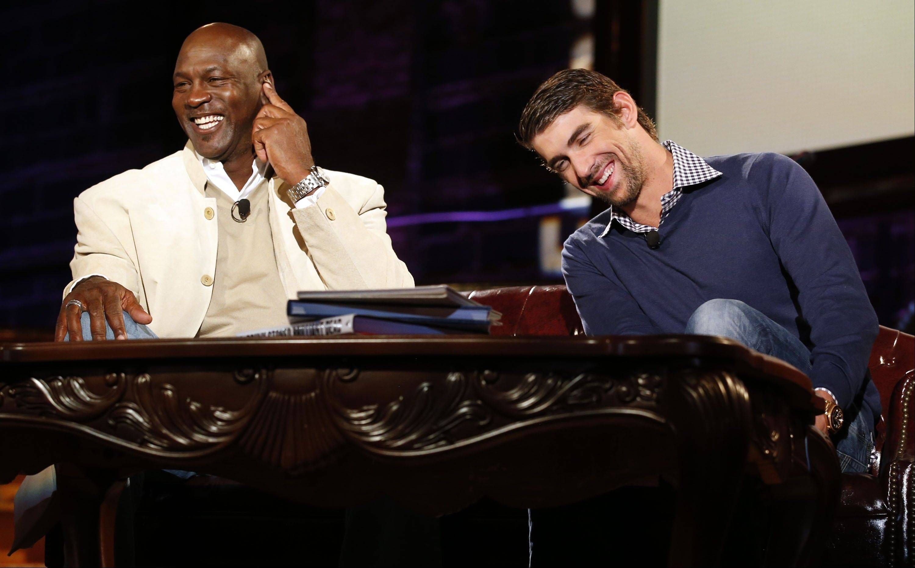 "Basketball legend Michael Jordan and Olympic swimming champion Michael Phelps share a laugh during The Golf Channel's ""Feherty Live from the Ryder Cup"" program, which was taped at the Tivoli Theatre in Downers Grove. The special airs at 8 p.m. Wednesday on The Golf Channel."