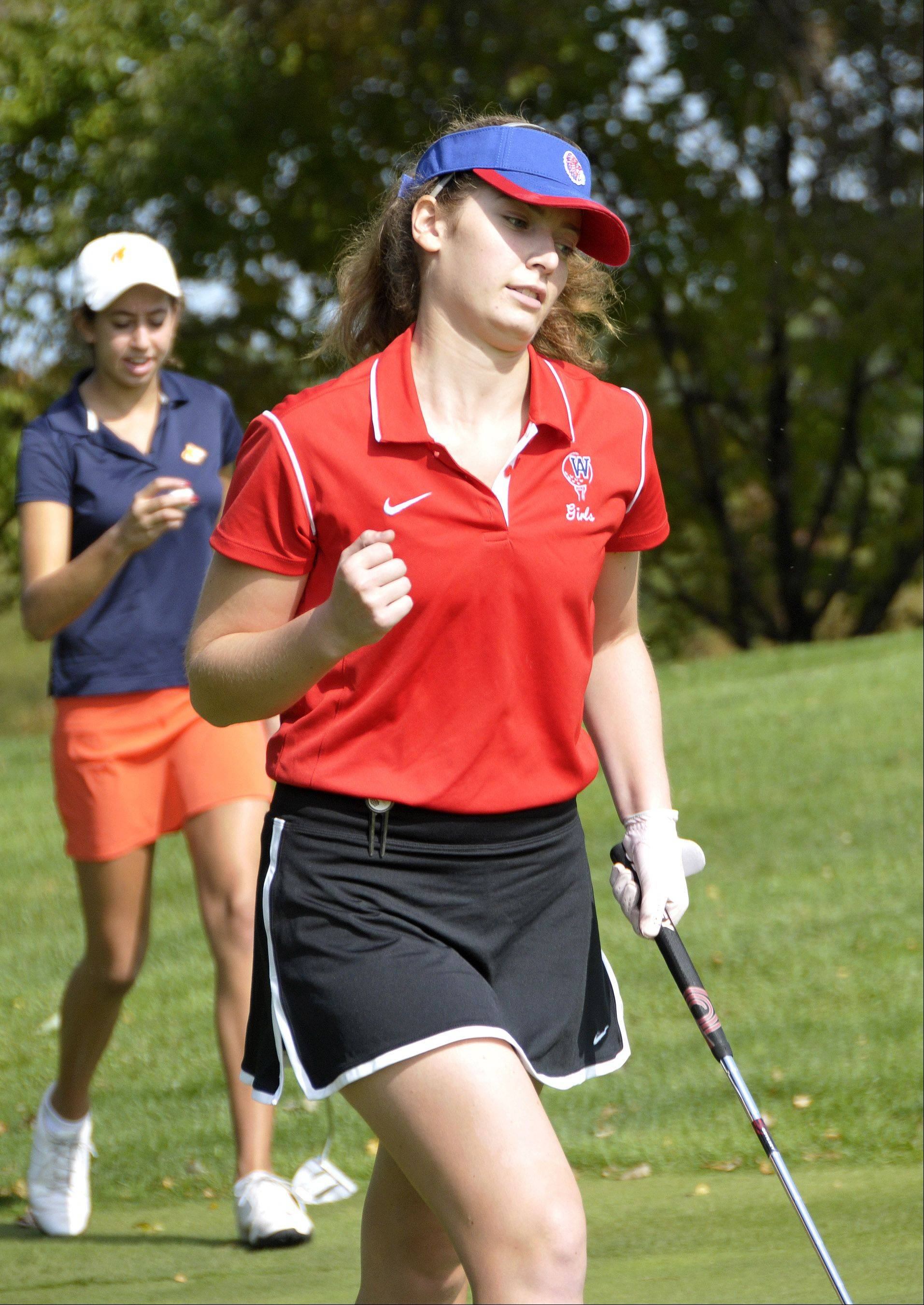 West Aurora's Kara Smith pumps her fist after making par on No. 10 at the DuPage Valley Conference meet at Phillips Park in Aurora.