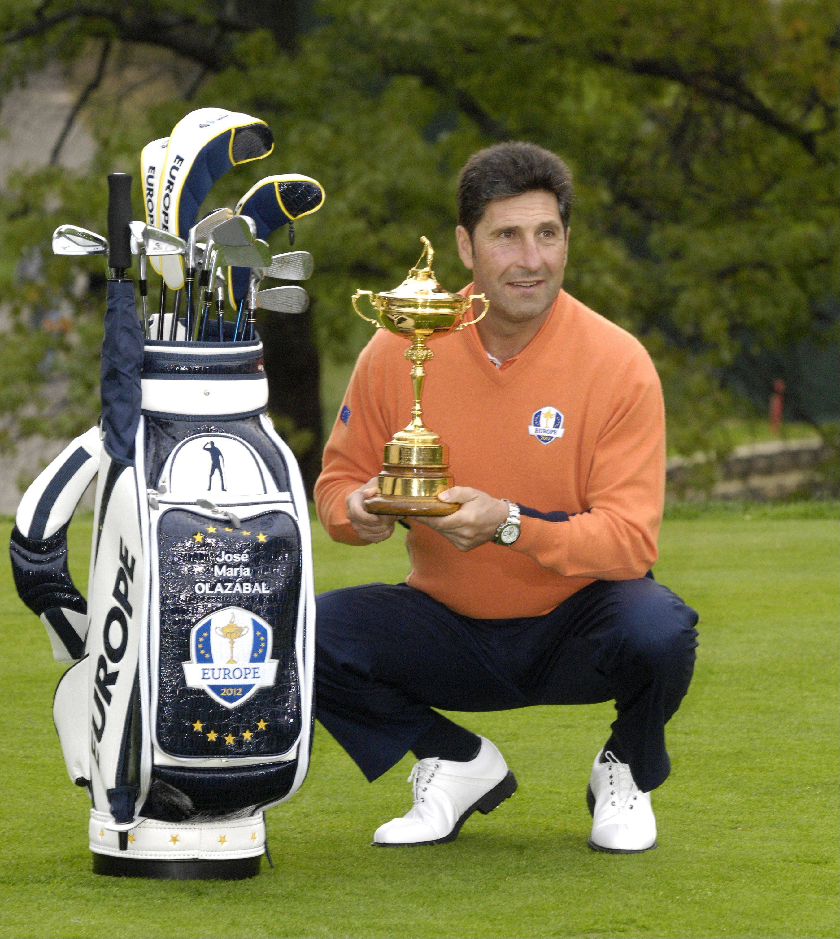 The European Ryder Cup team captain Jose Maria Olazabal poses for a portrait with the Ryder Cup Trophy and team.