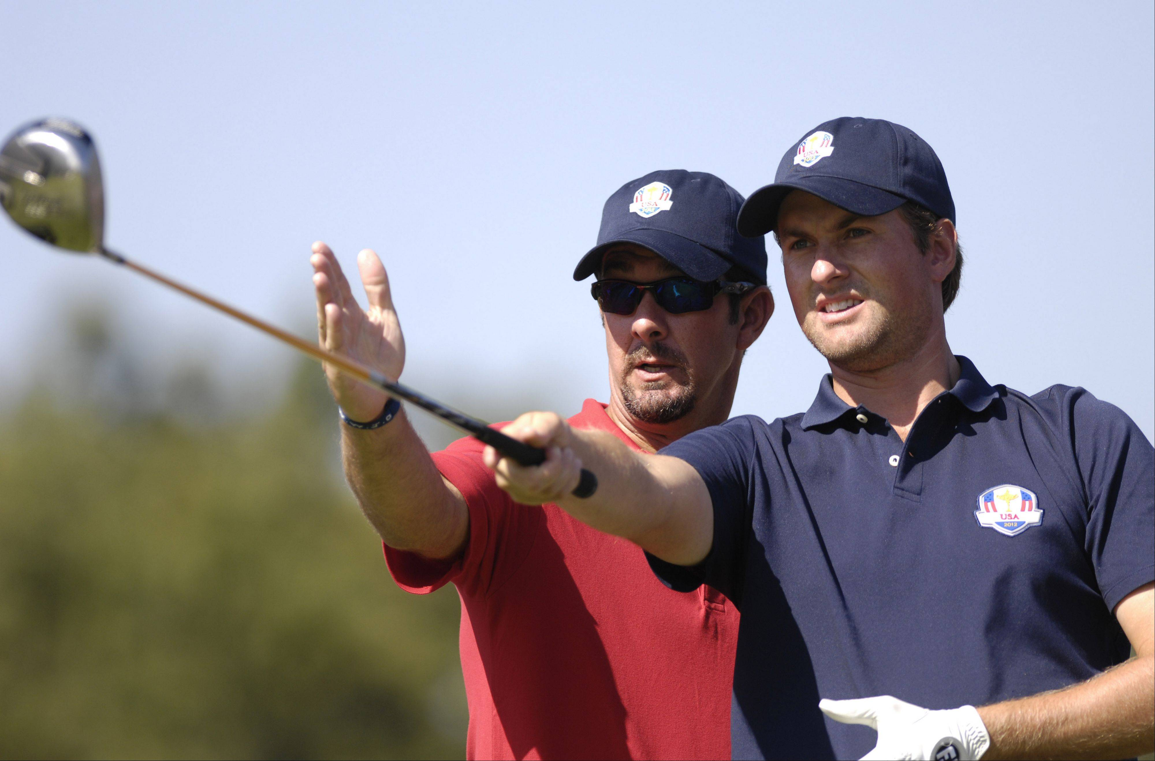 Team USA's Webb Simpson gets some advice from his caddie Paul Tesori.