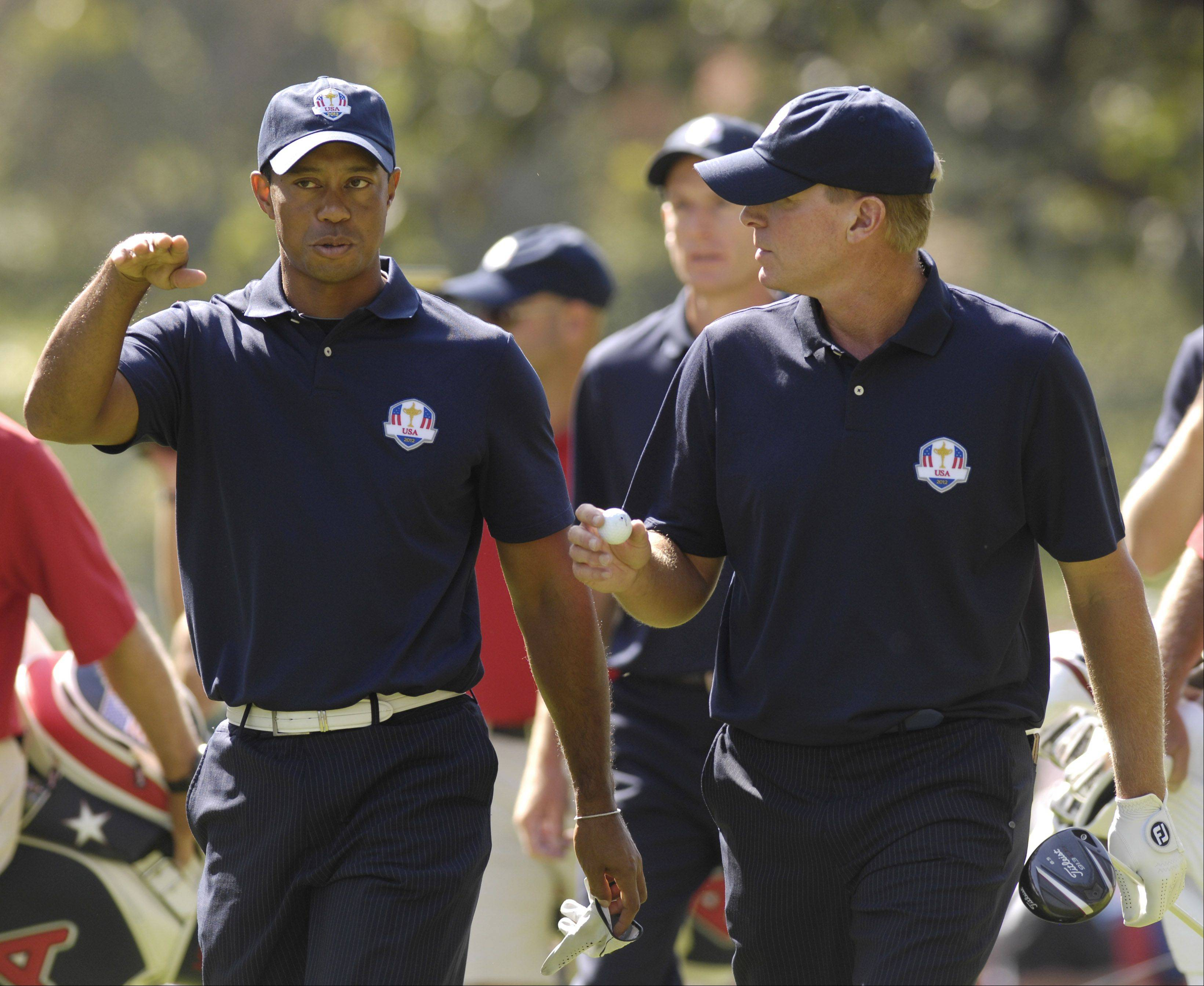 Team USA's Tiger Woods, left, and Steve Stricker chat.
