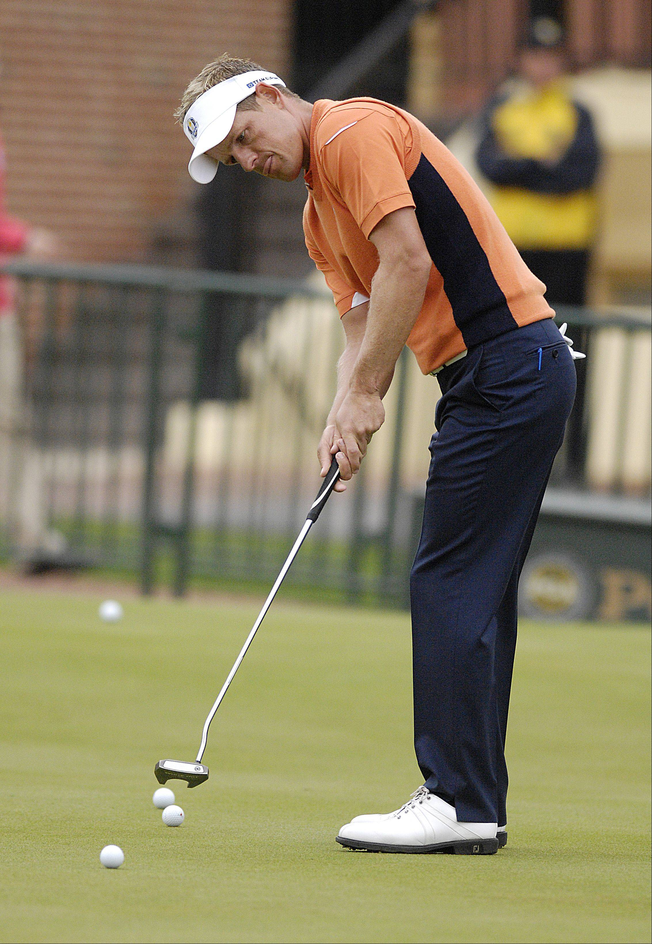 Luke Donald of the European Ryder Cup Team putts on the practice green.