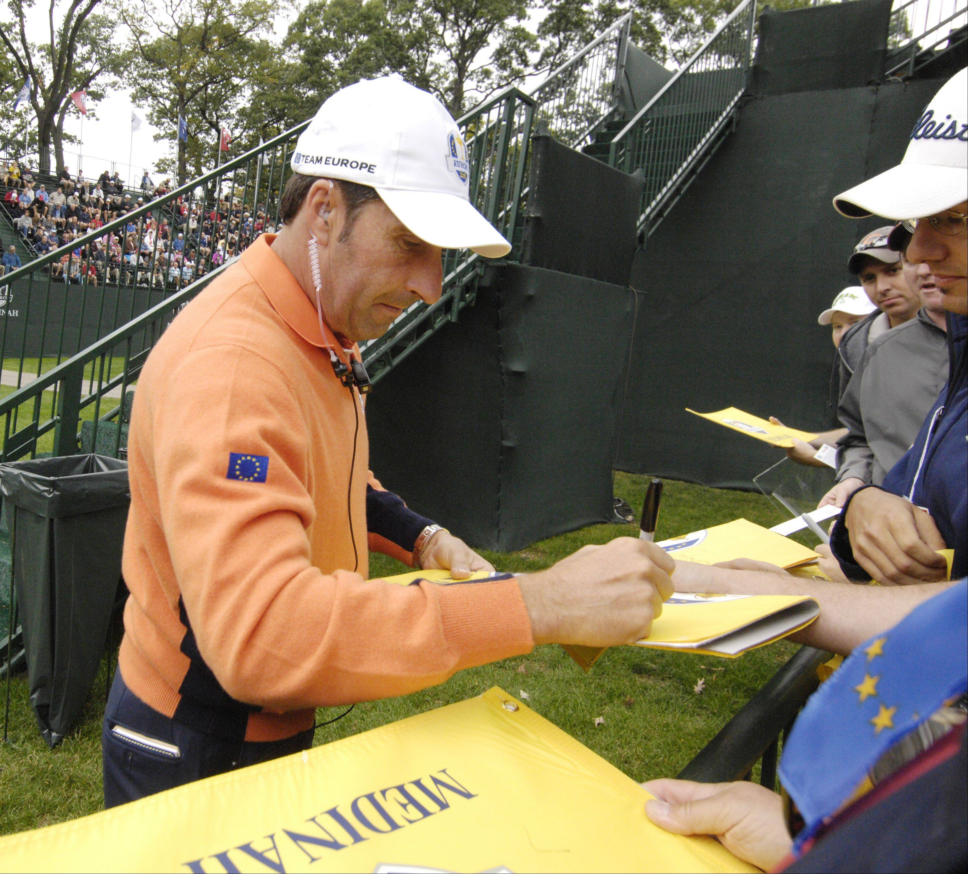 European Ryder Cup Team captain Jose Maria Olazabal signs autographs.