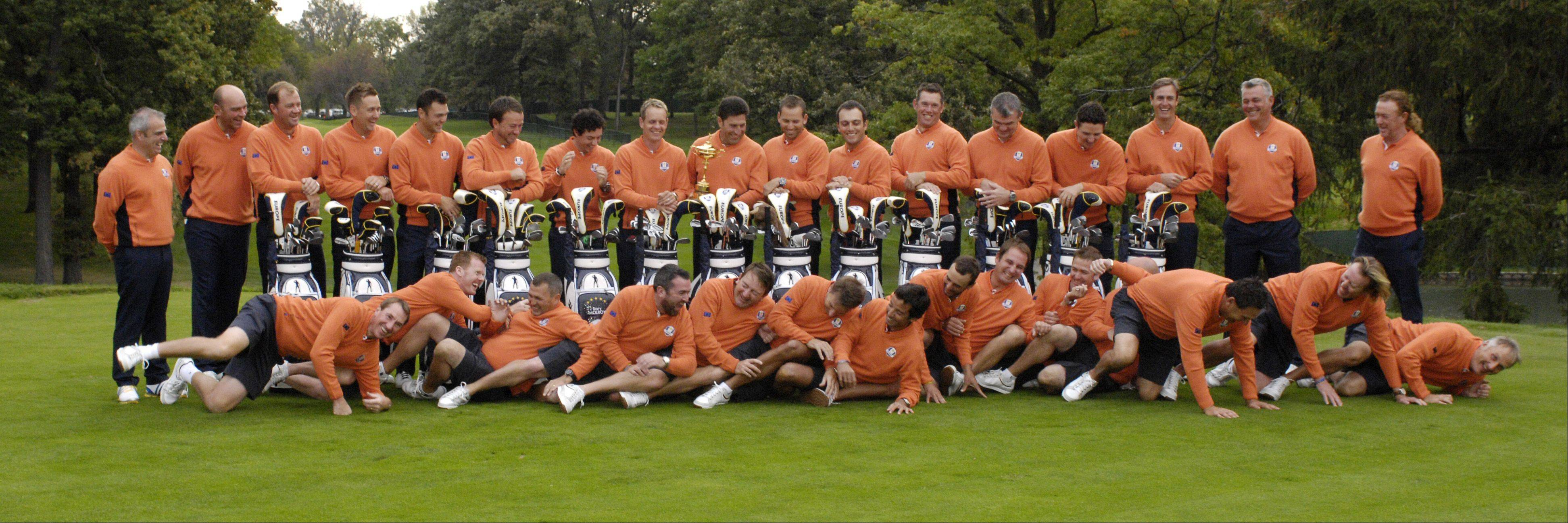 The European Ryder Cup team caddies goof around during a team portrait.