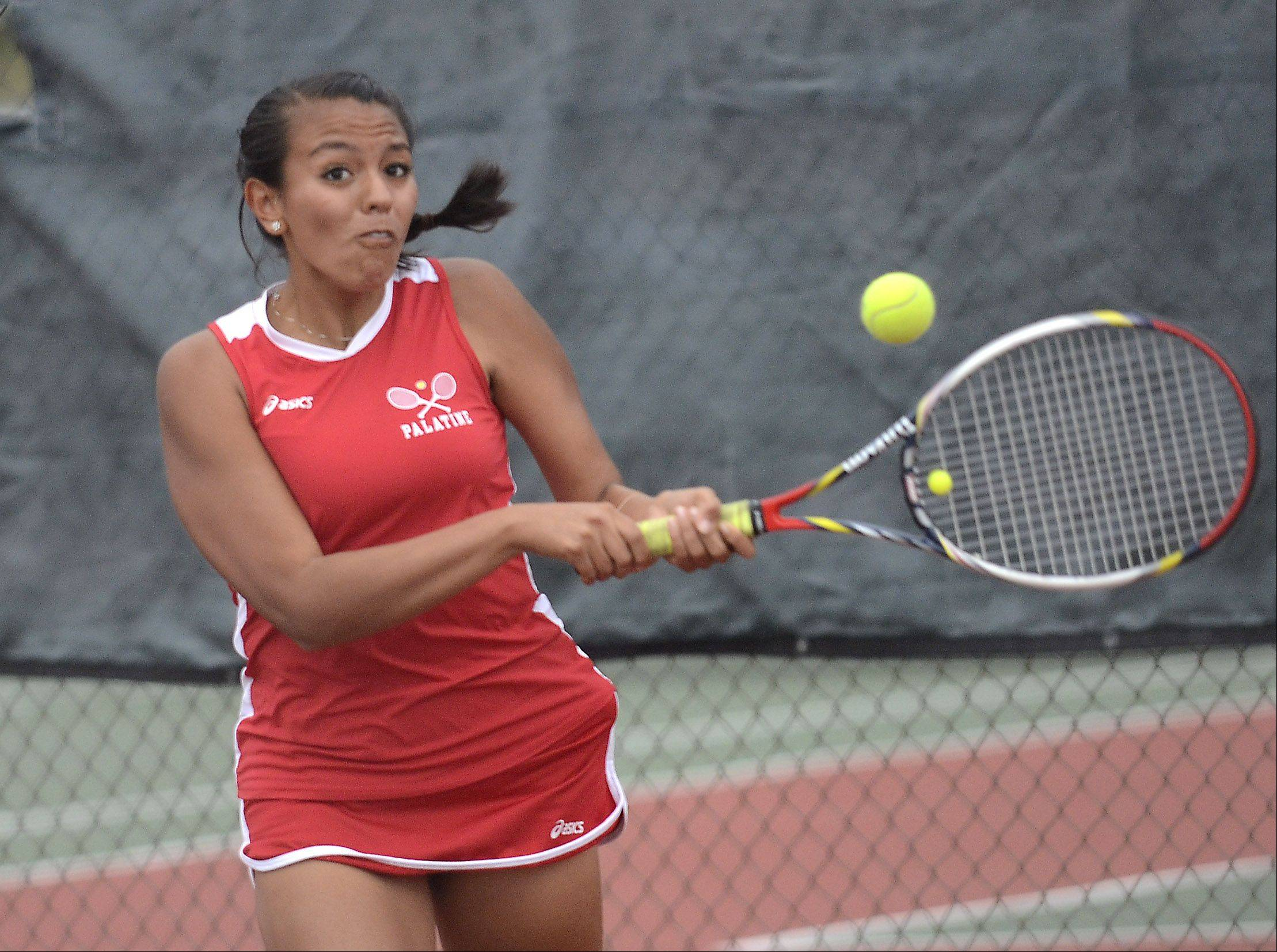 Palatine's Karla Robles plays St. Viator's Megan Balas in girls tennis action Monday in Palatine.