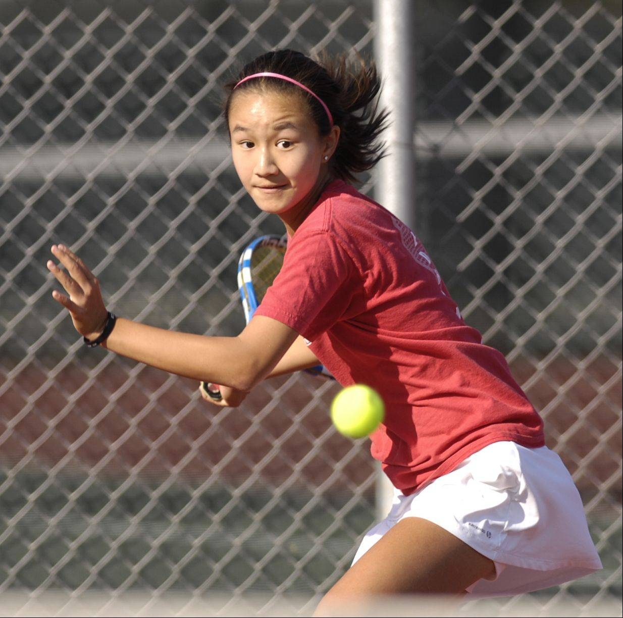 Naperville Central's Tiffany Chen plays against Anusha Pai of Neuqua Valley in girls varsity tennis on Wednesday.