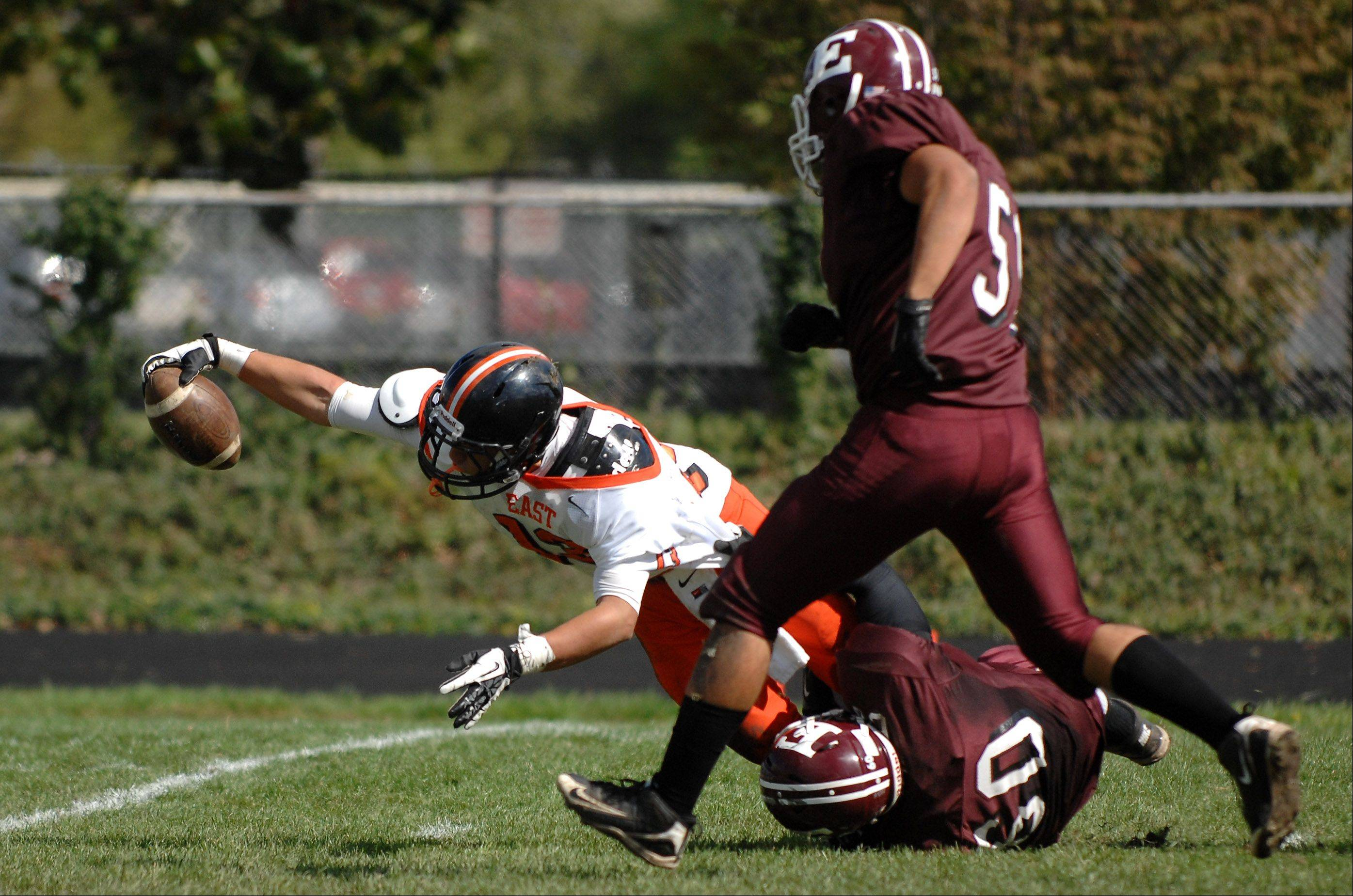 St. Charles East's Anthony Sciarrino dives and stretches for the goal line against Elgin at Memorial Field Saturday.