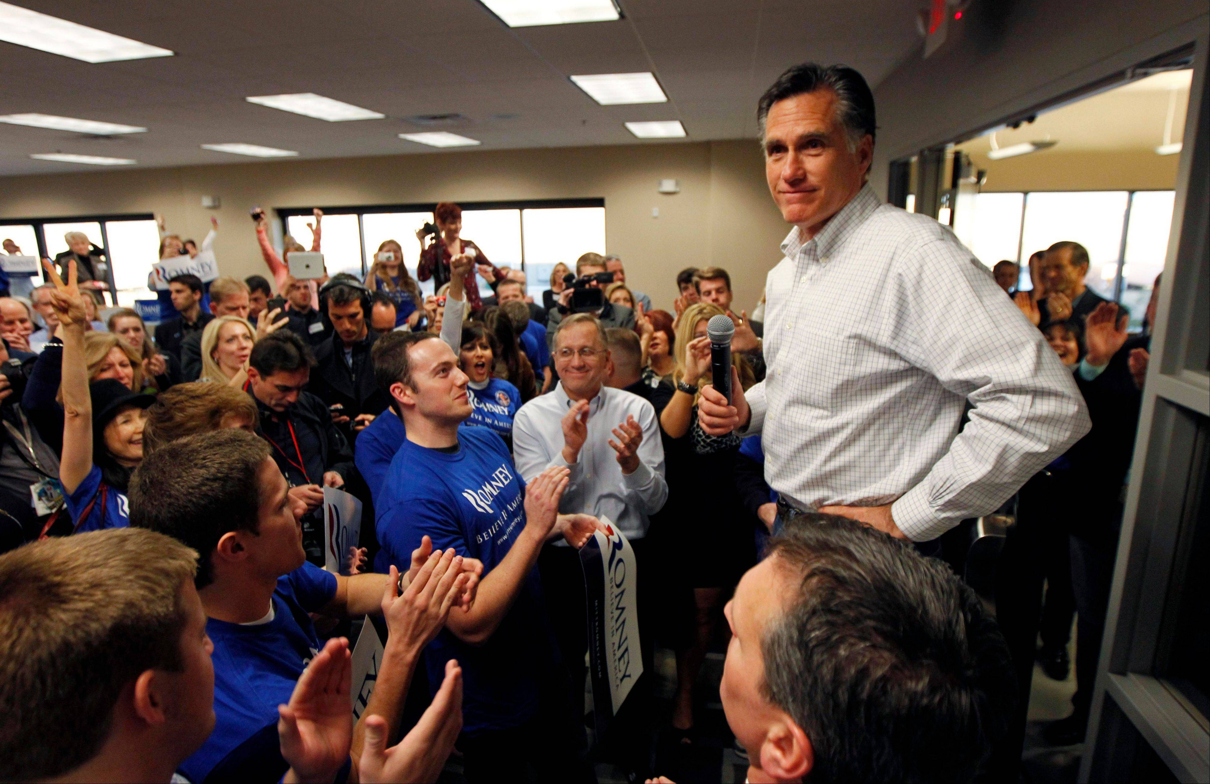 Republican presidential candidate, former Massachusetts Gov. Mitt Romney, greets campaign volunteers at a phone banking center in Las Vegas, Nev.