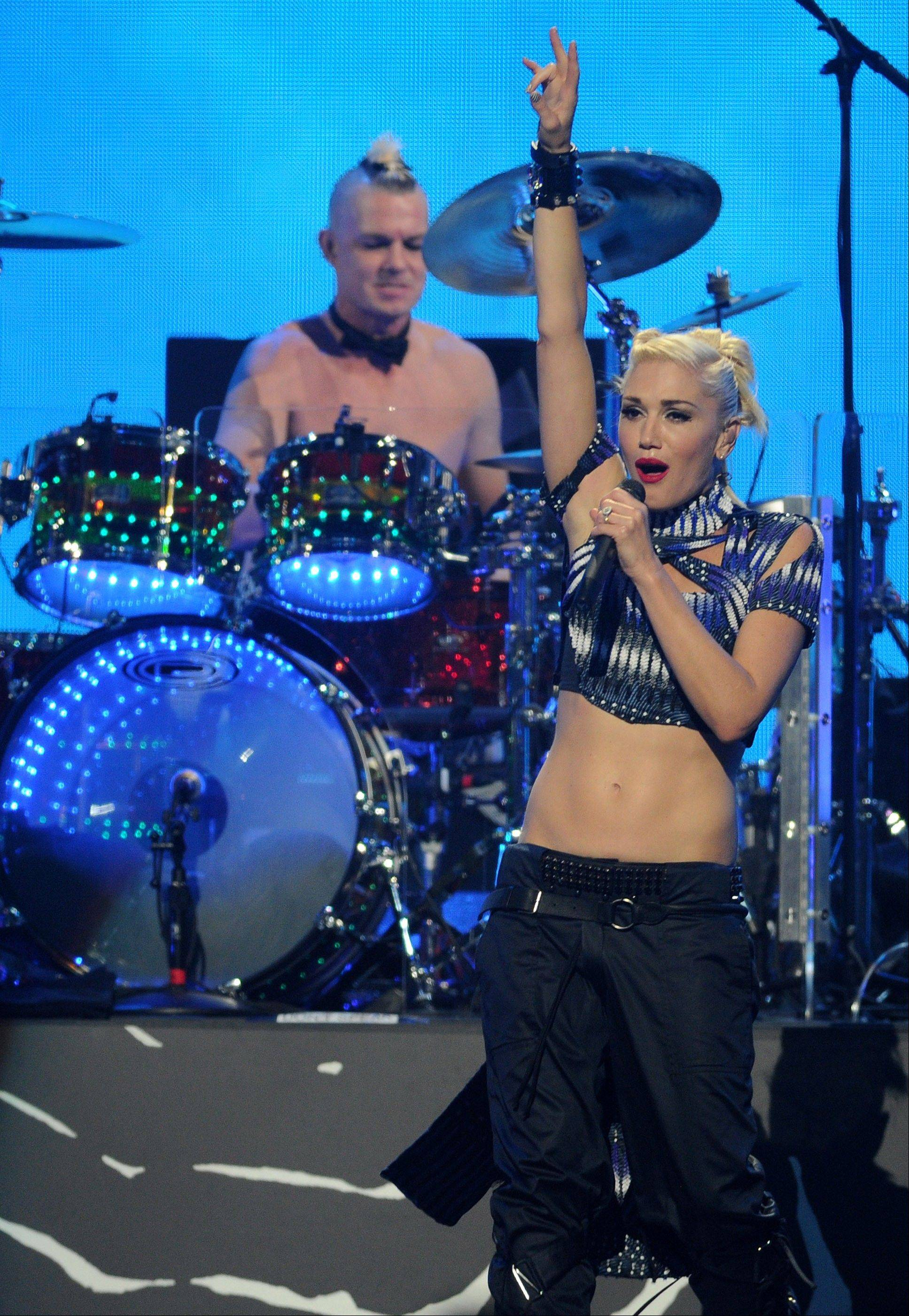 "Gwen Stefani and drummer Adrian Young of No Doubt performed Friday at the iHeart Radio Music Festival in Las Vegas to promote the band's new album, ""Push and Shove."""