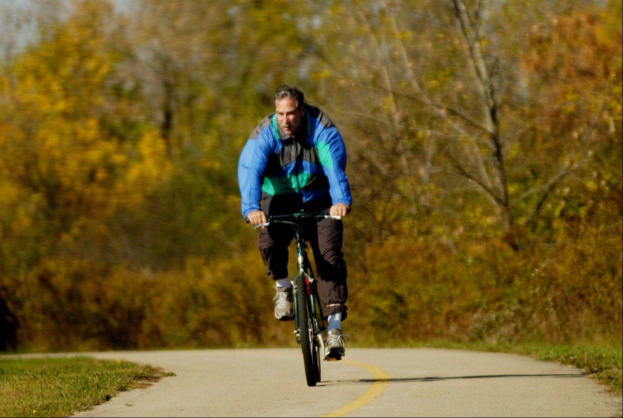 This is a file photo of a bicyclist riding the Poplar Creek bike trail in Hoffman Estates. Police said they will have bike patrols out looking for a teenager who robbed two joggers of their cellphones.