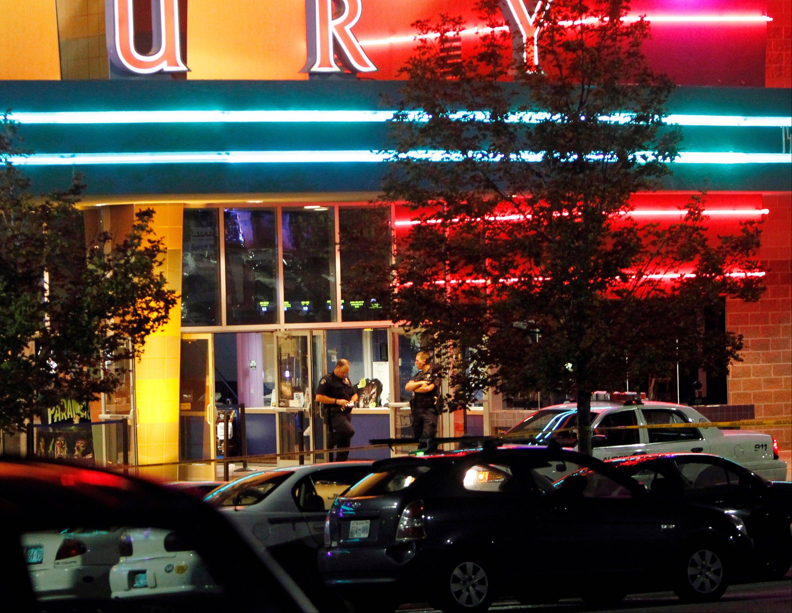 This July 20 file photo shows police outside movie theatre in Aurora, Colo., after a shooting during the showing of a movie. Guns are used in two-thirds of homicides, according to the FBI.