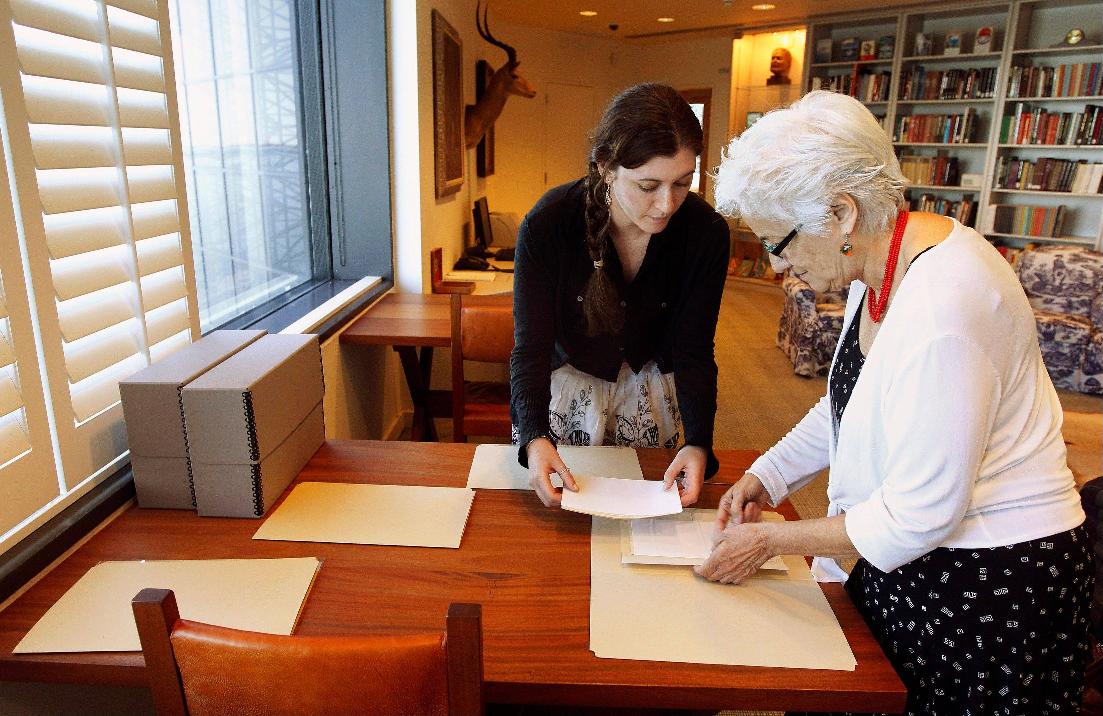 Hemingway curator Susan Wrynn, right, and intern Jessica Green collate documents from the Hemingway collection at the John F. Kennedy Library and Museum in Boston.
