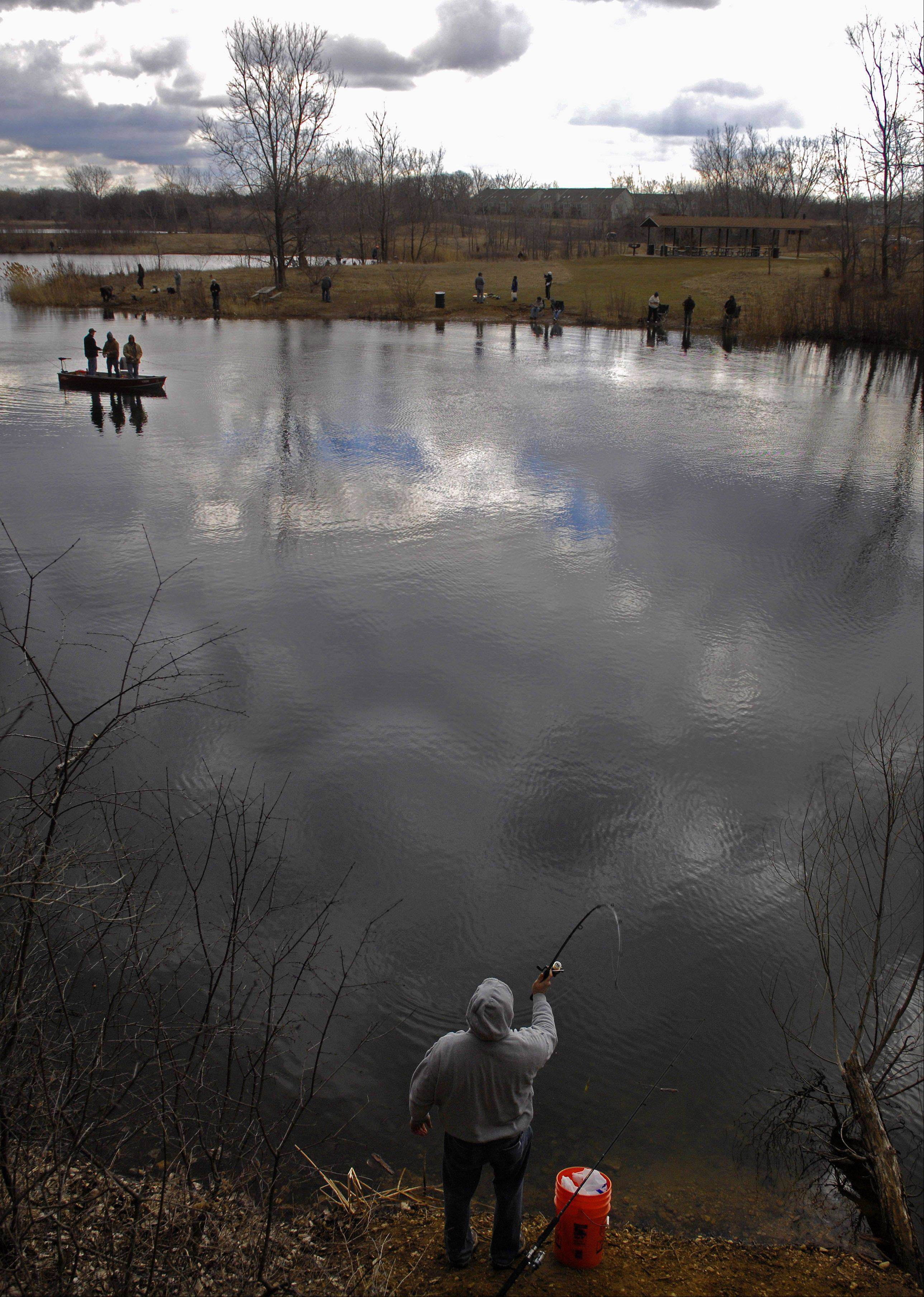 Marck Ishcar of Crystal Lake casts as he joins other fisherman during the opening of trout fishing season 2011 at Lake Atwood at the Hollows Conservation Area in Cary.
