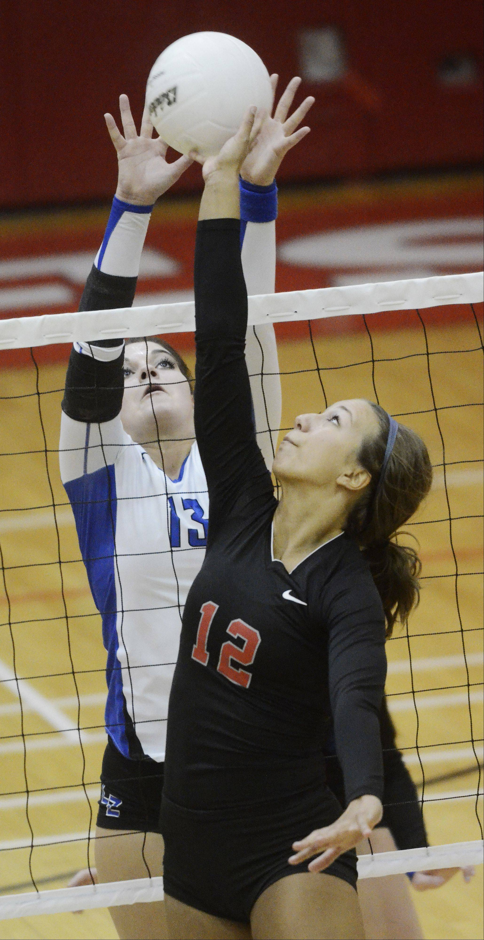 Palatine�s Alex Heidrich, right, tries to tip the ball past Lake Zurich�s Mallory Parsons during Wednesday�s game.