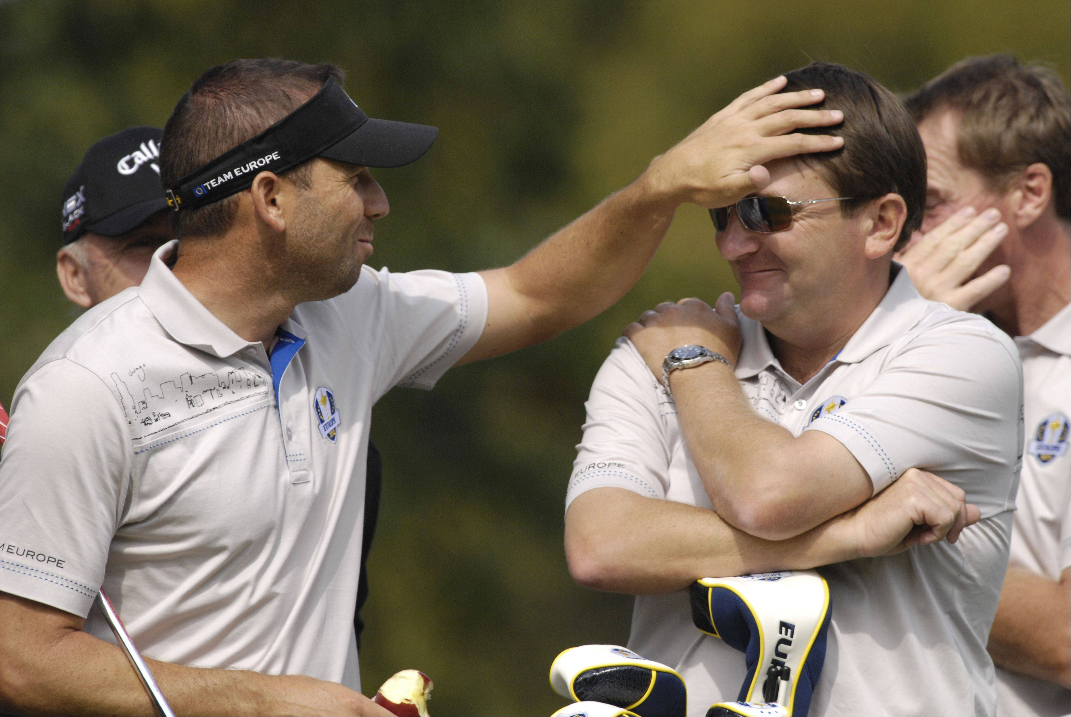 Sergio Garcia of Team Europe pats down the hair of a member of the Team Europe support staff, during practice for the 2012 Ryder Cup.