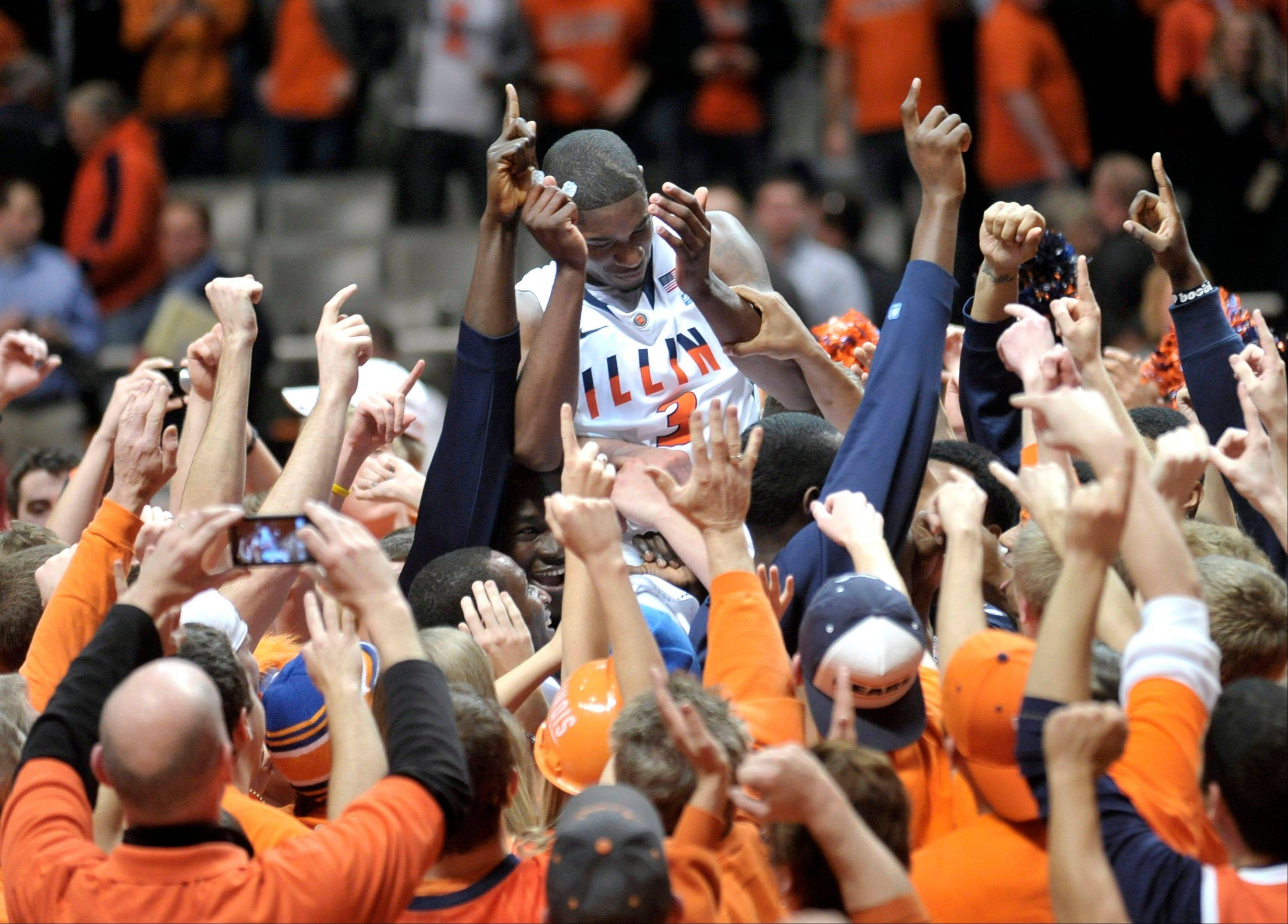 Former Warren High School star Brandon Paul returns for another season of college basketball at Illinois. He was instrumental in the Illini upseting Ohio State last January.