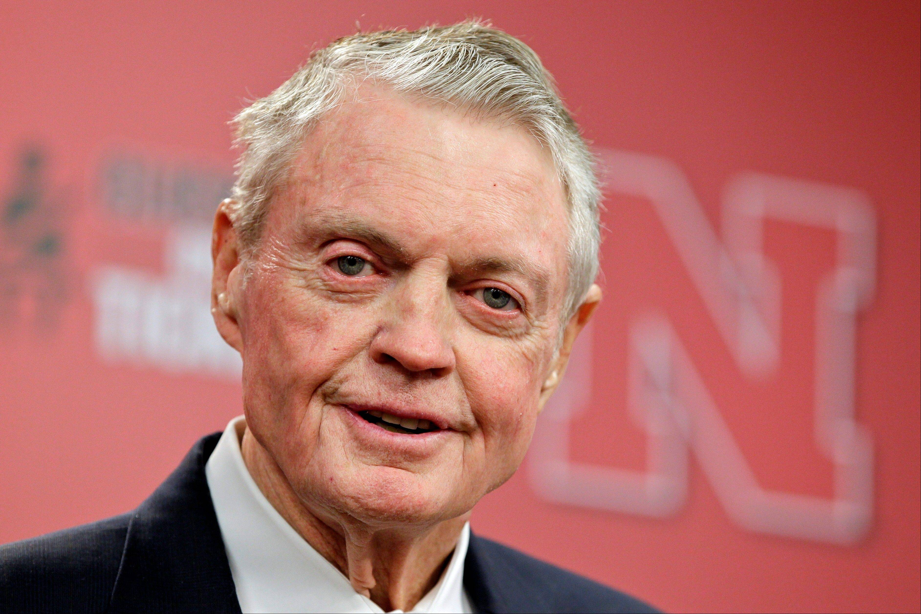"Nebraska athletic director Tom Osborne jokes about his health Wednesday as he announces his retiring as of Jan. 1, during a news conference held in Lincoln, Neb. The 75-year-old Osborne said ""the perception"" that you're getting old ""can get in the way."" He also said he didn't want to be a distraction."