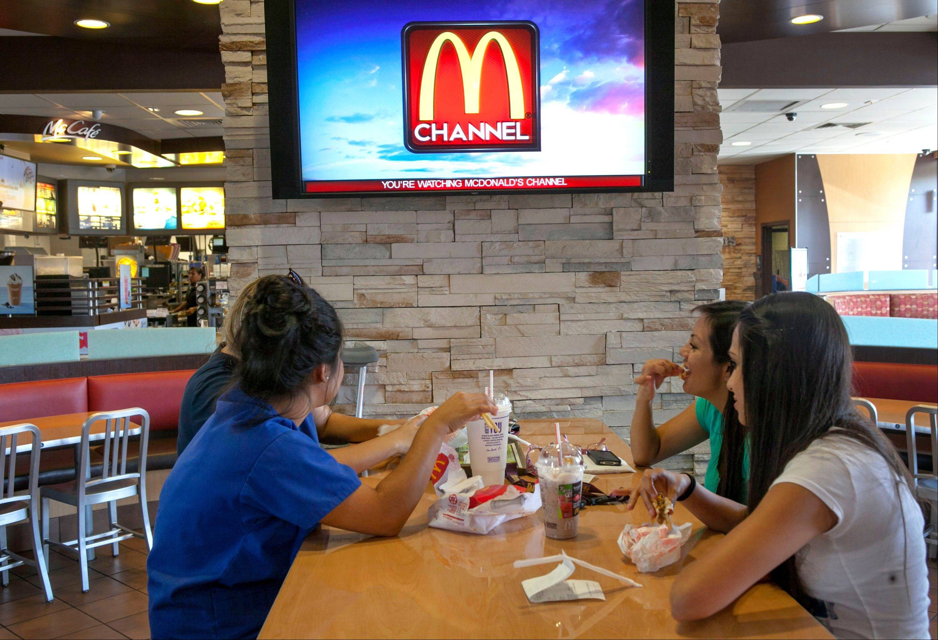 McDonald's patrons watch the new McDonald's television channel at a McDonald's restaurant in Norwalk, Calif. McDonald's is testing its own TV channel in 700 California restaurants in a pilot project that could expand to all the company's restaurants.