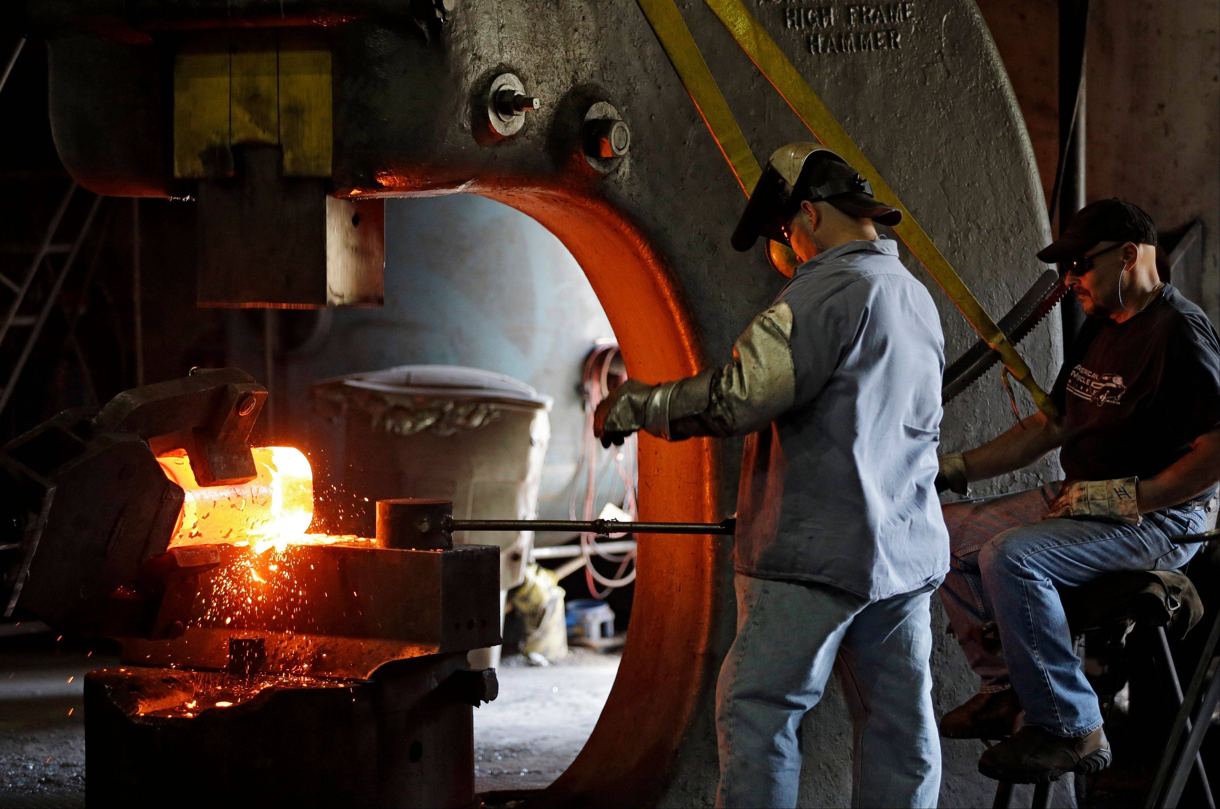 Workers form a large spindle from glowing hot metal at Solmet Technologies in Canton, Ohio. Americans are more confident in the economy than they have been in seven months, an encouraging sign for President Barack Obama with six weeks left in the presidential race.