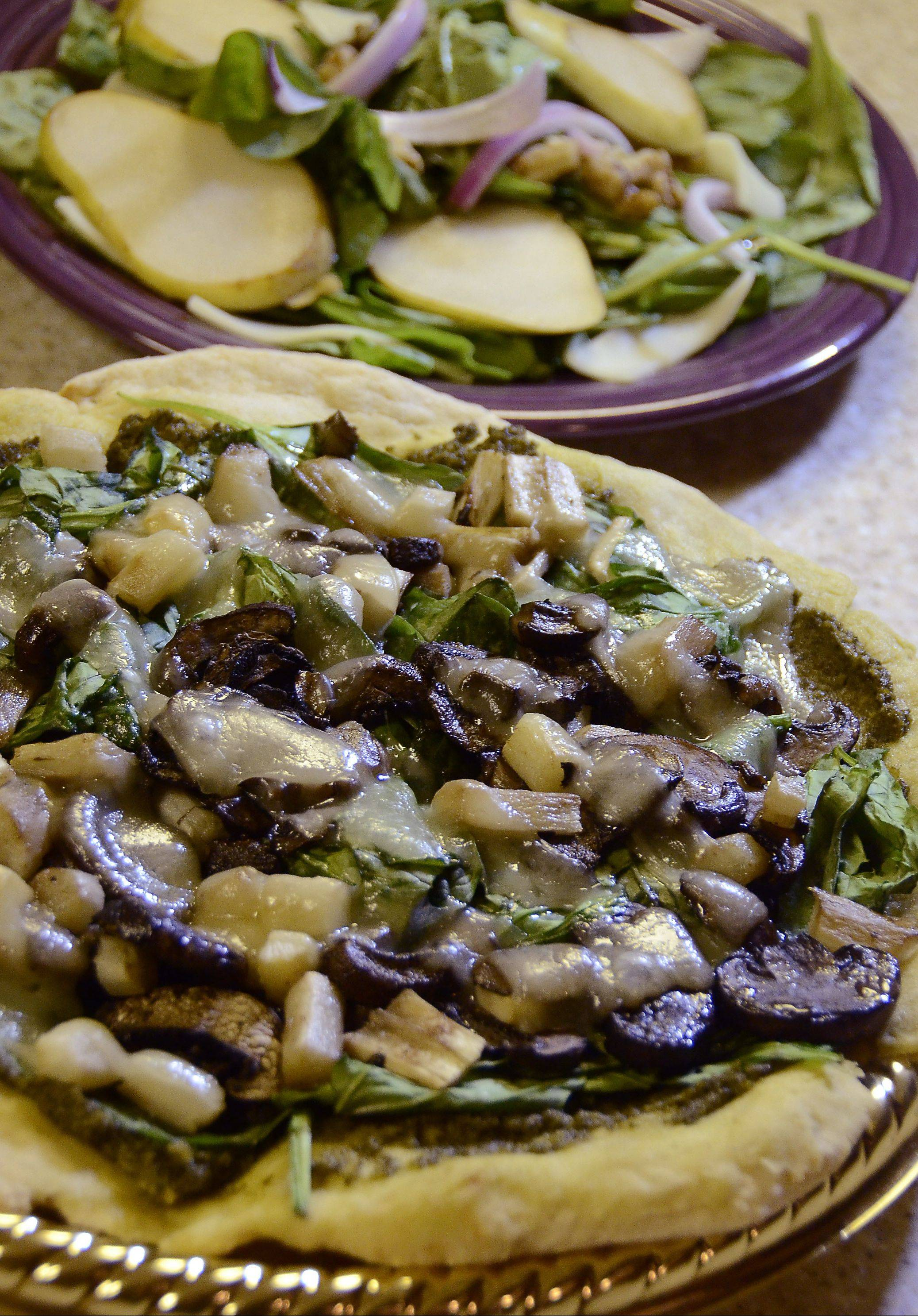 Michelle Abraham tops gluten-free pizza crust with roasted salsify root and mushrooms and serves a pear and spinach salad on the side.