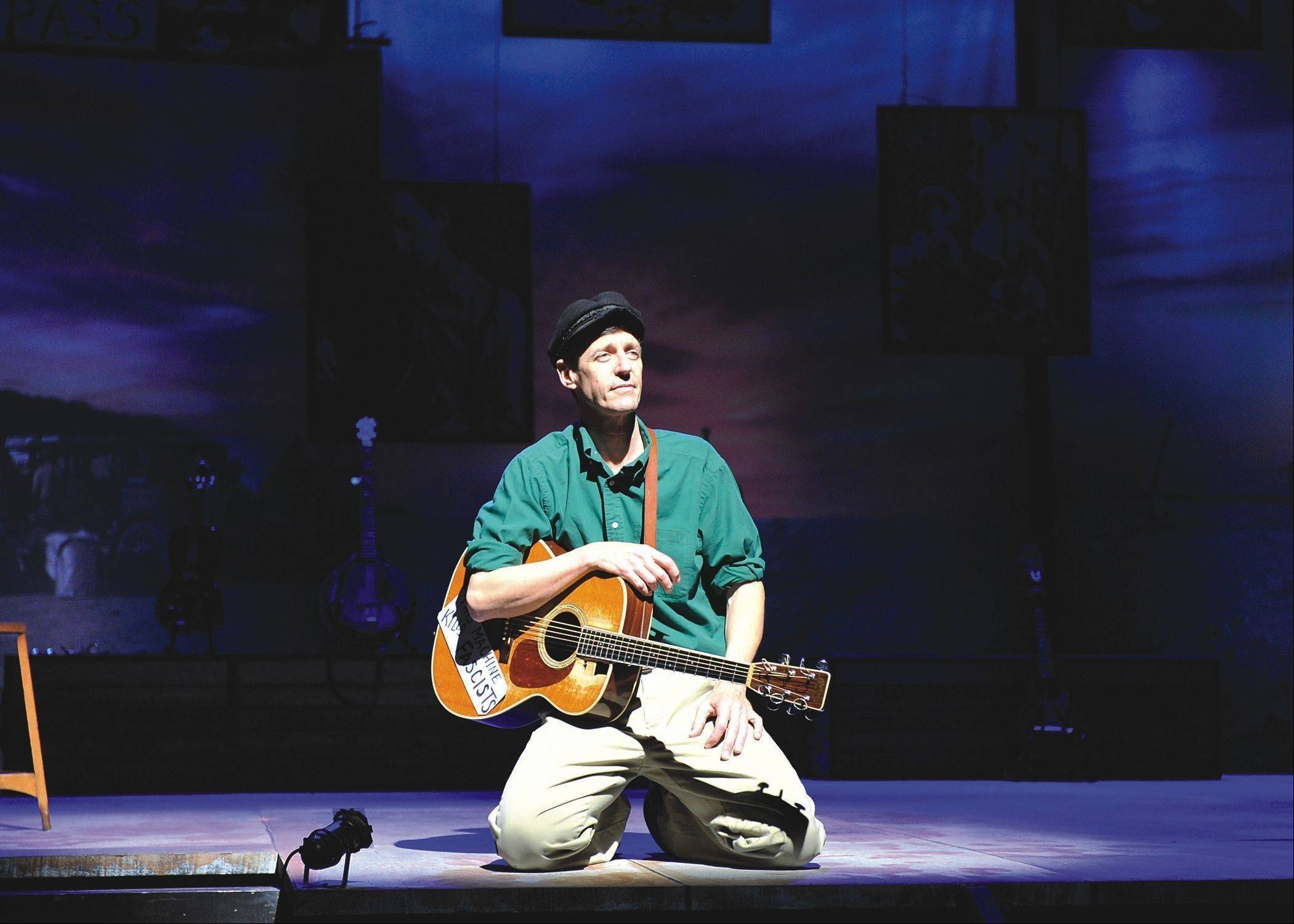 "Singer/guitarist David M. Lutken stars as the iconic American folk singer Woody Guthrie in the heartfelt bio-musical revue ""Woody Sez: The Life and Music of Woody Guthrie,"" running through Oct. 21 at Northlight Theatre."