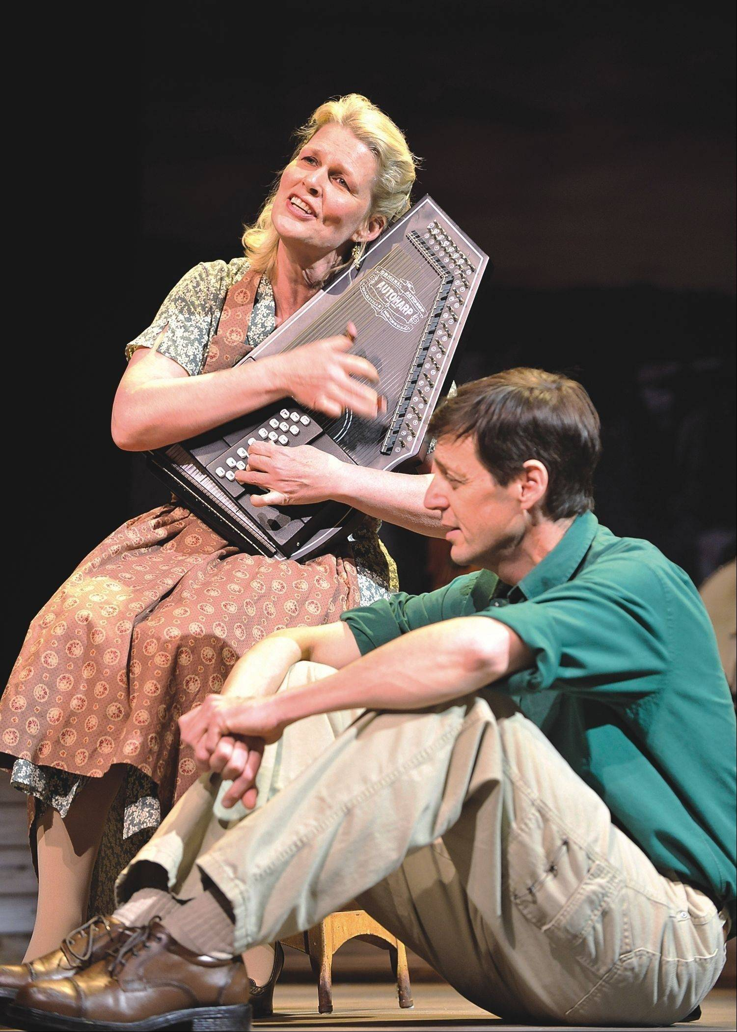 "Helen J. Russell plays Woody Guthrie's mother and David M. Lutken plays young Guthrie, the folk-music icon who learned to love music through her, in Northlight Theatre's production of the bio-musical ""Woody Sez."""