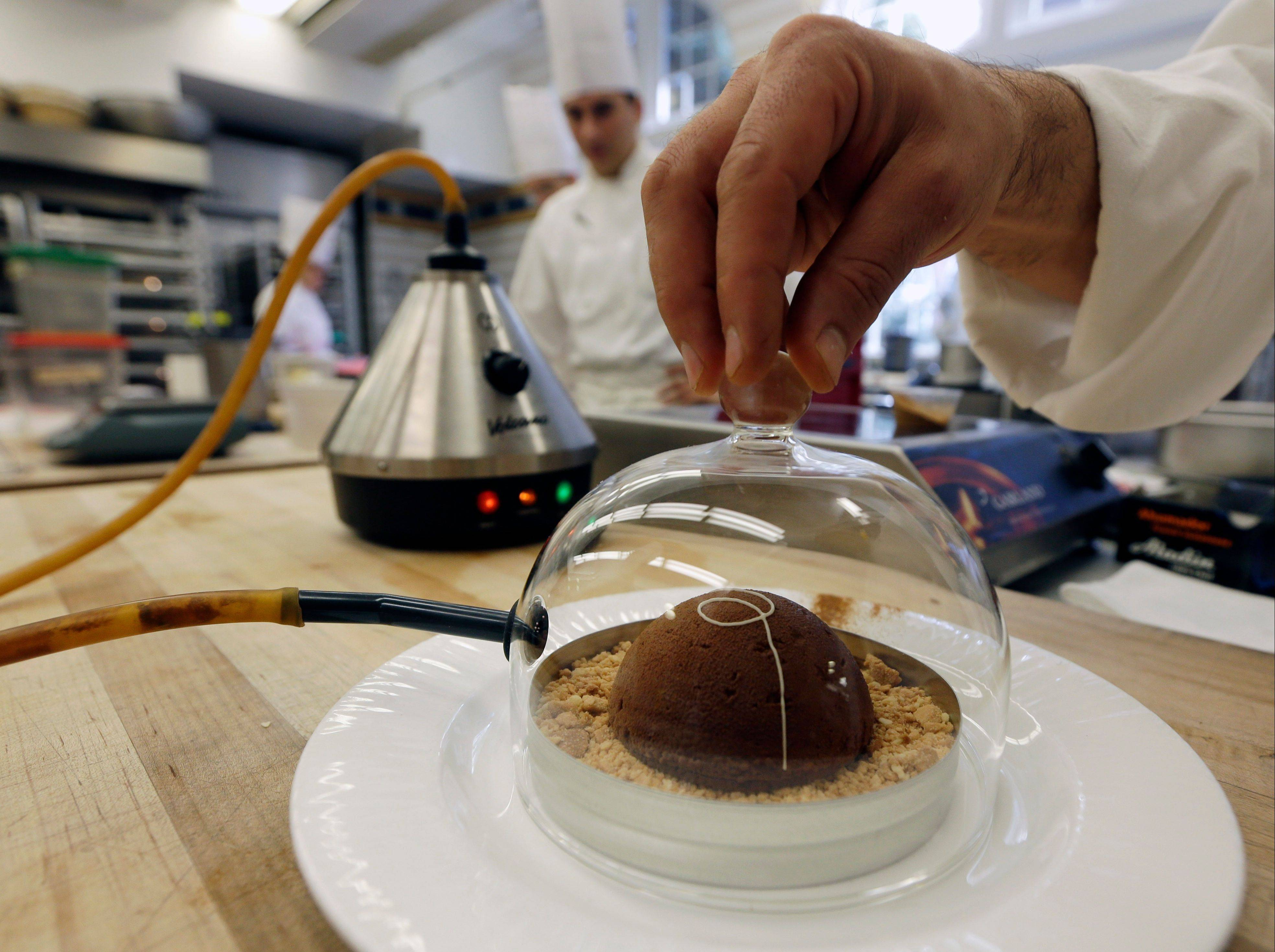 Cinnamon aroma is added to a peanut butter and milk chocolate dome dessert at the Culinary Institute of America in Hyde Park, N.Y. This esteemed cooking school north of New York City is dramatically pumping up science instruction, saying that tomorrow's chefs will need more technical know-how in the age of molecular gastronomy and sous-vide.