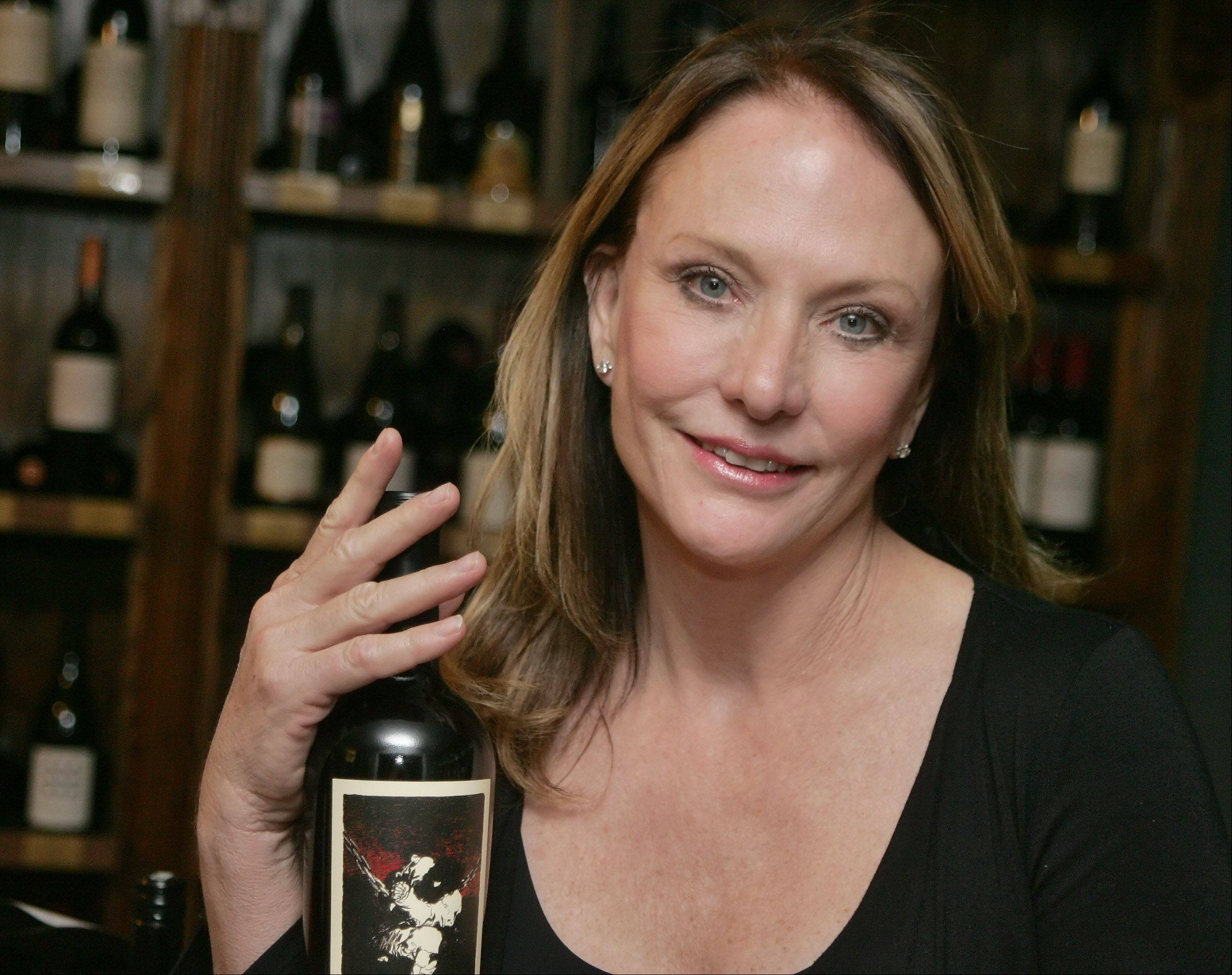Owner Shelley Simon serves a selection of wines and wine-friendly foods at WineSplash in Long Grove.