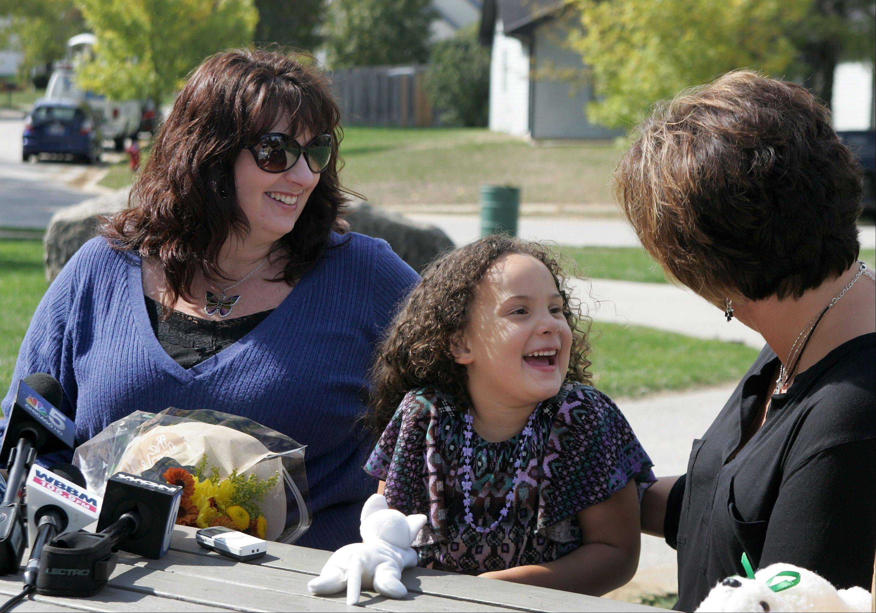 Diana Jensen and her daughter, Livia, 4, meet with Aurora 911 dispatcher Jill Schmidt three days after Schmidt answered Livia's 911 call and dispatched medical help to their home for Jensen, who has Lupus and was dealing with intense pain.