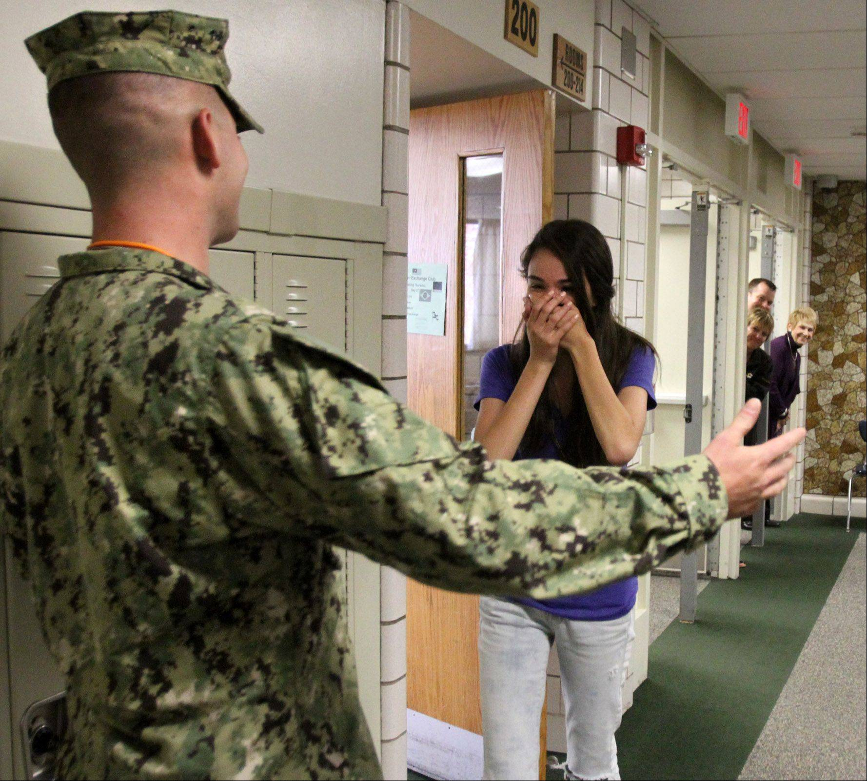 Petty Officer 3rd Class Cameron Schwartz of the U.S. Navy, who was deployed in Afghanistan for eight months, surprises younger sister Jackie Trujillo during her Spanish class Wednesday at Fremd High School.